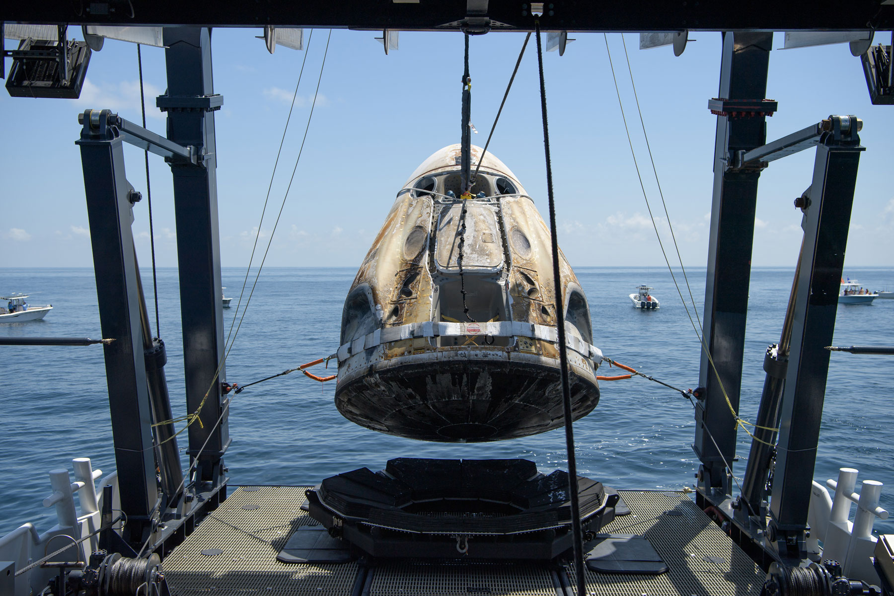 SpaceX's Crew Dragon capsule lifted out of the water