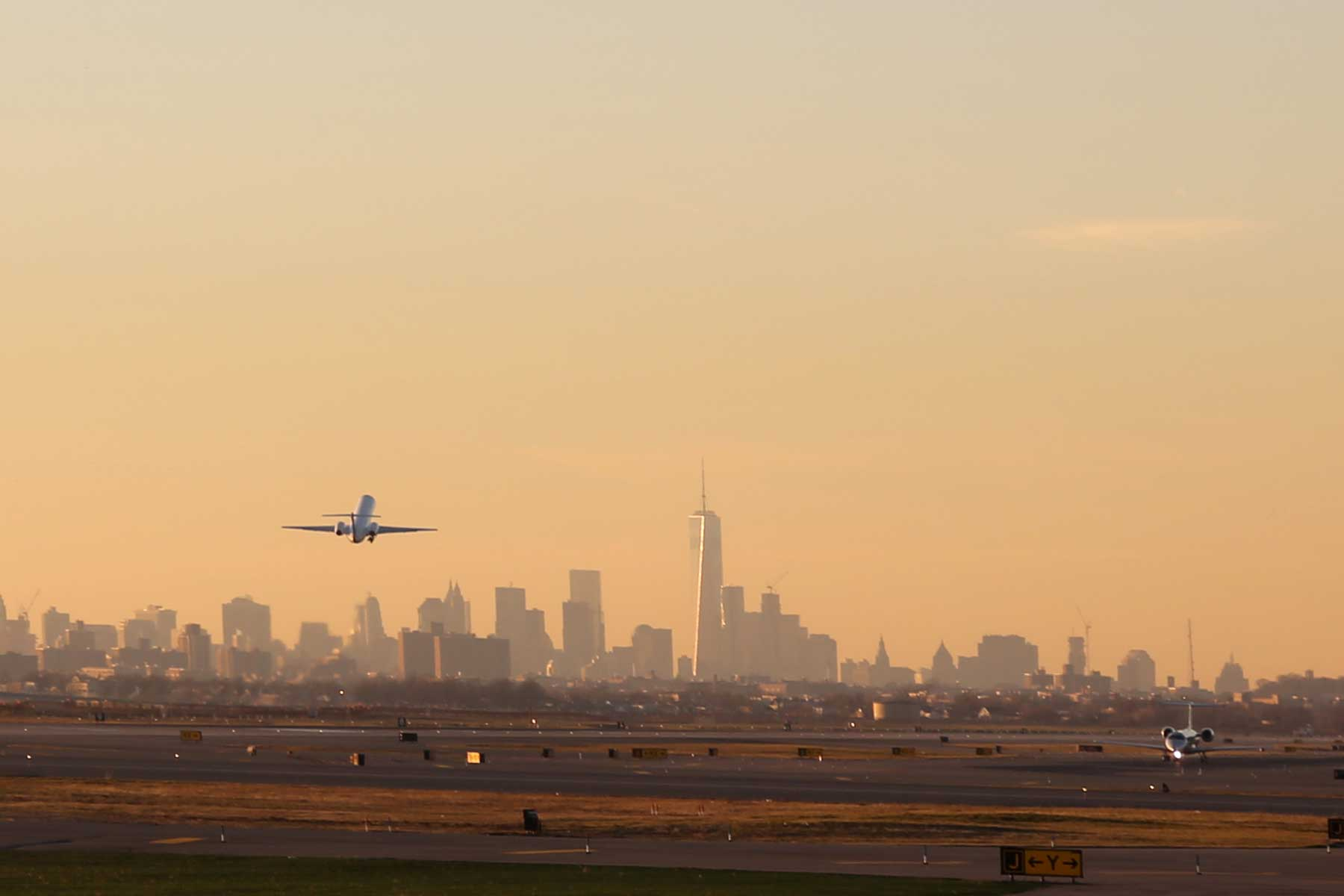 Airplane Take Off from JFK Airport with New York City Skyline