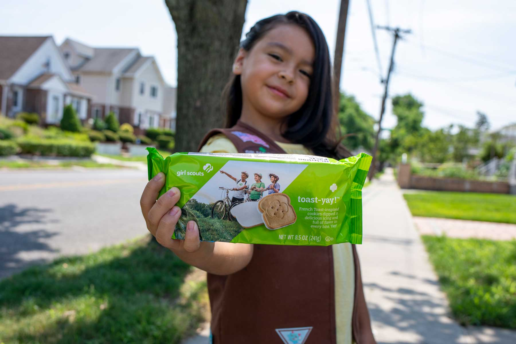 Girl Scout with new box of cookies in hand