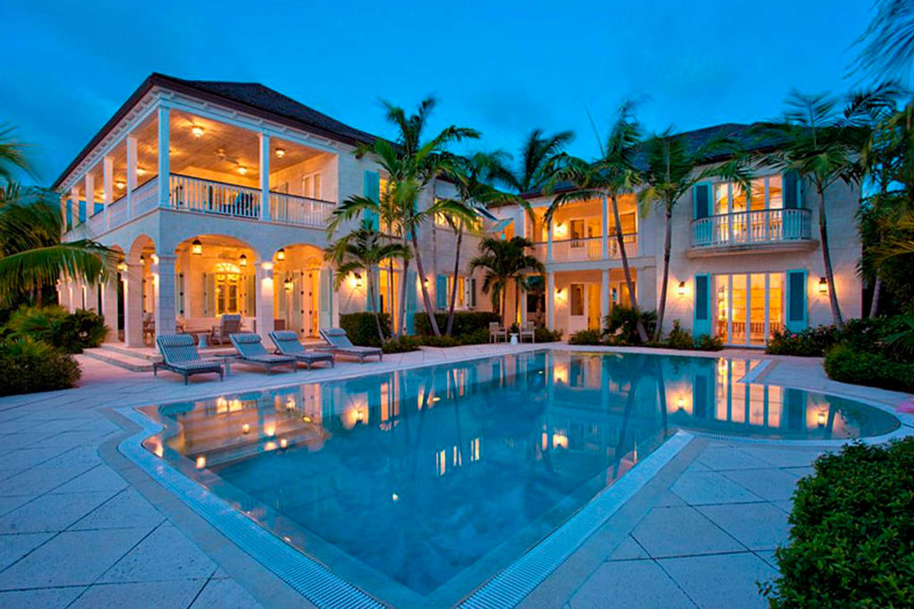 Private villa and pool at night in Turks and Caicos at Grace Bay