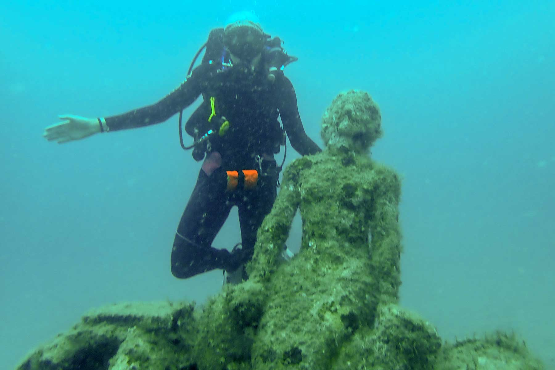 Scuba diver underwater with sculpture of mermaid in Florida