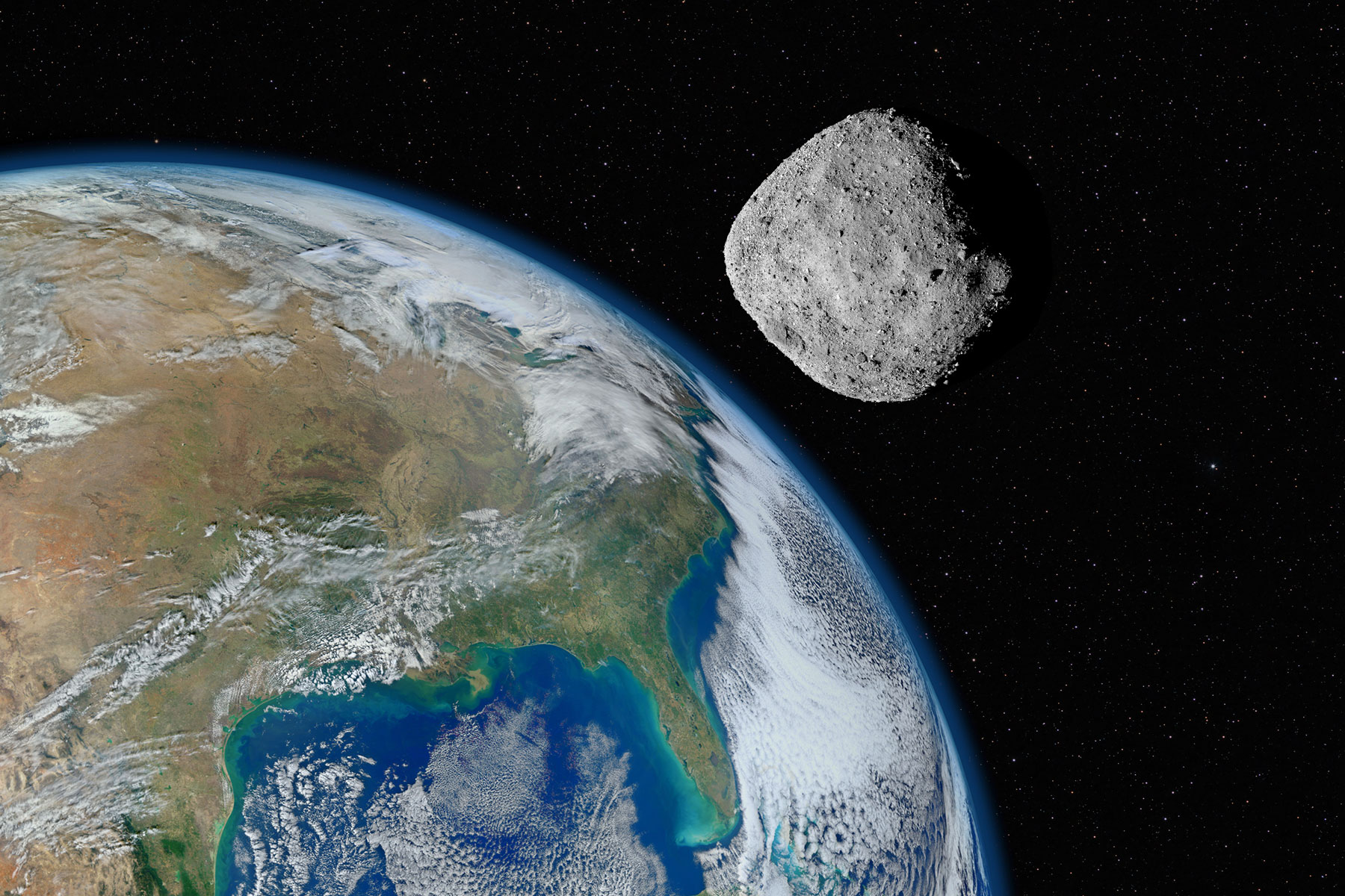 asteroid approaching planet Earth