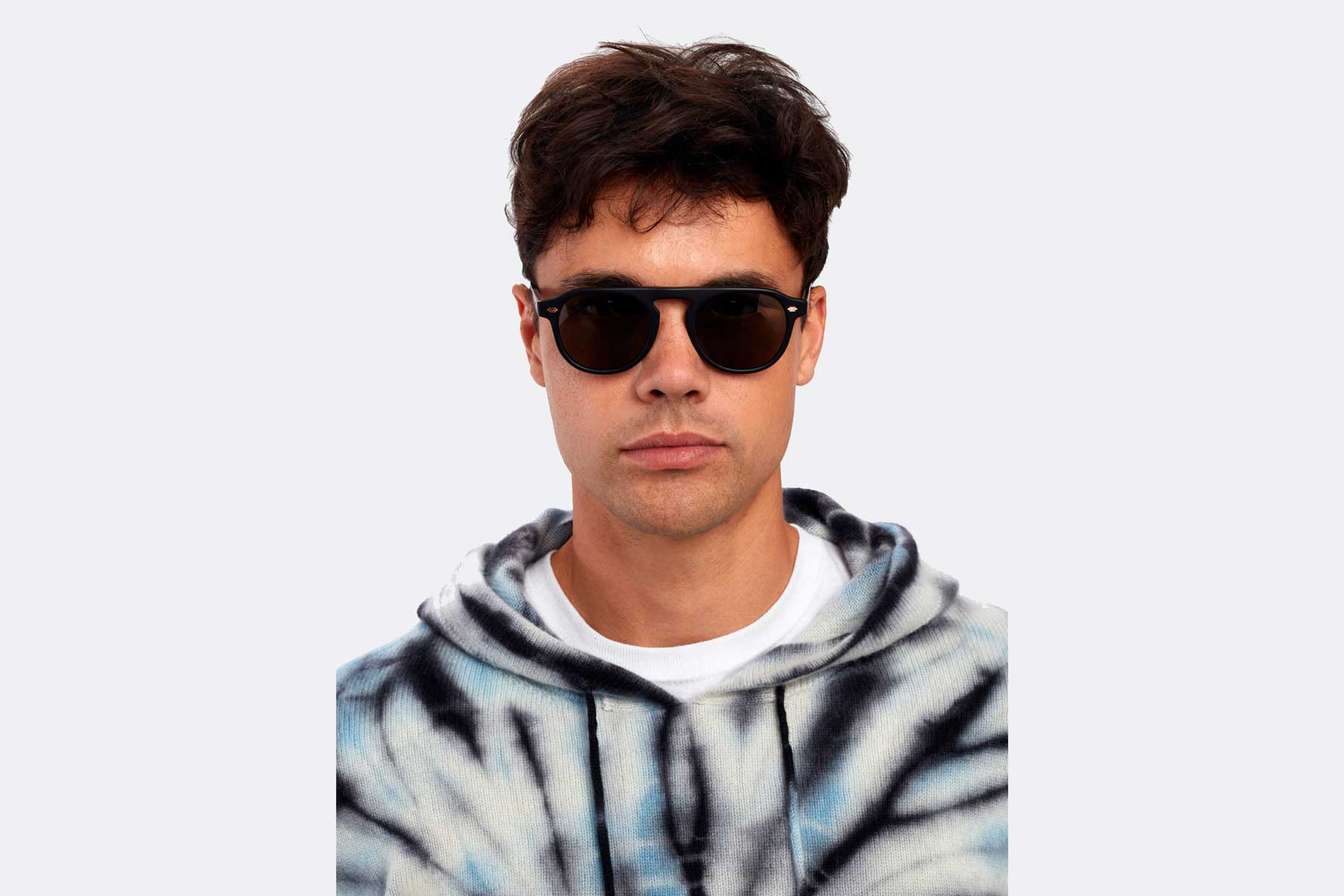 Garrett Leight sunglasses being modeled by young man in tie-dye hoodie
