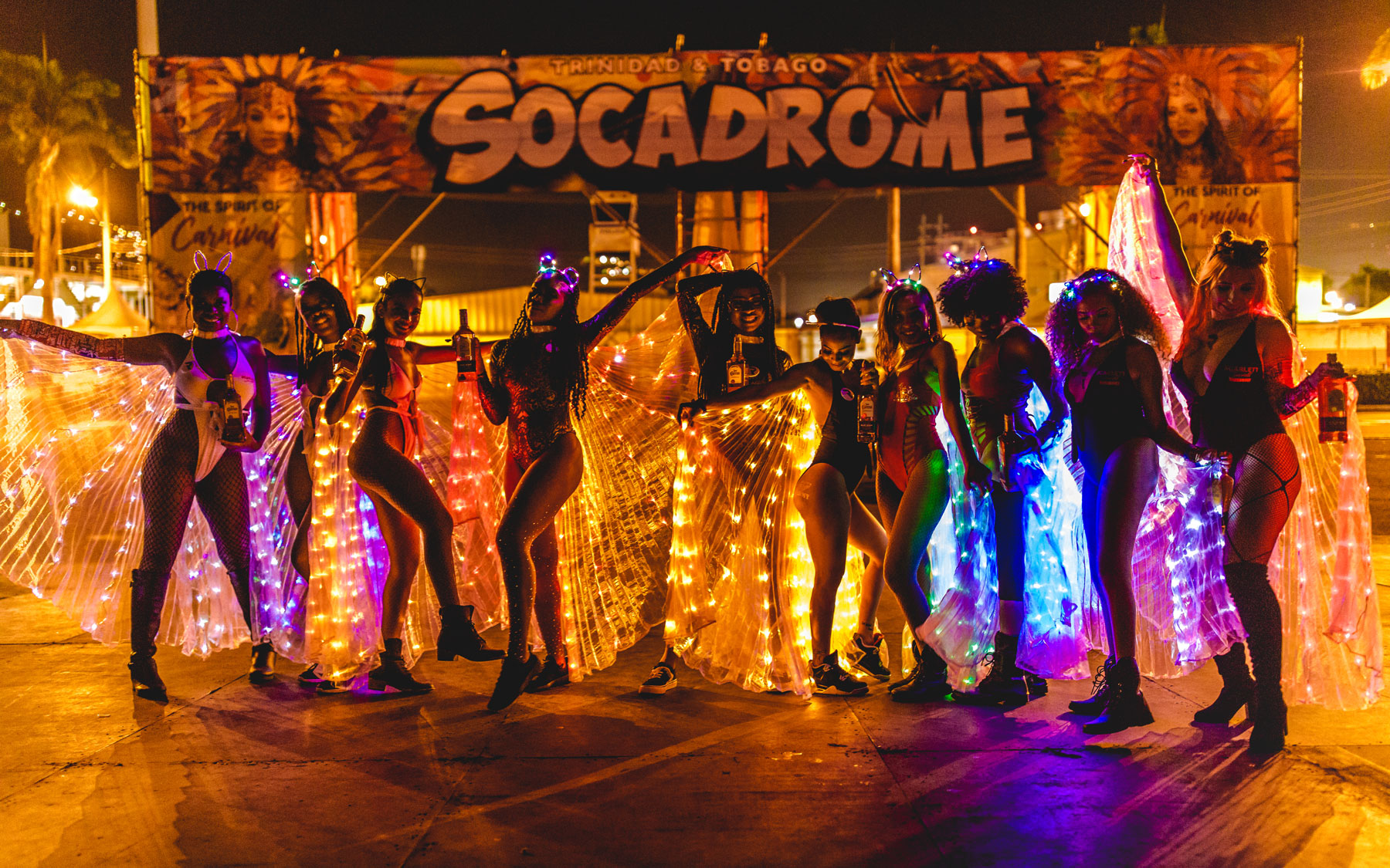 Women in light-up costumes at Carnival