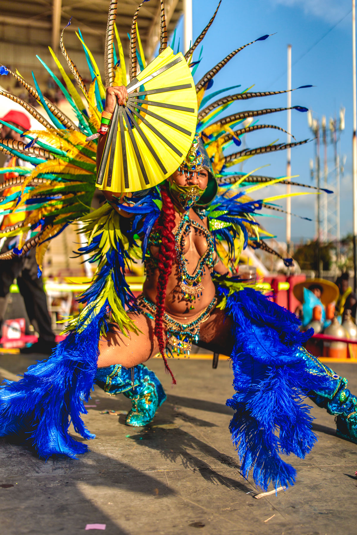 Carnival dancer in yellow and blue outfit
