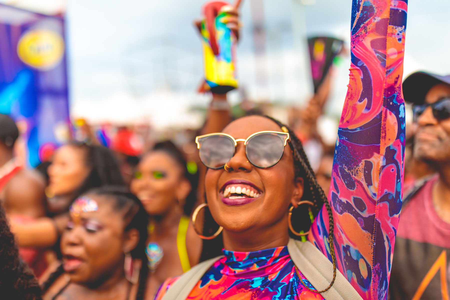 Women in crowd smiling at Carnival