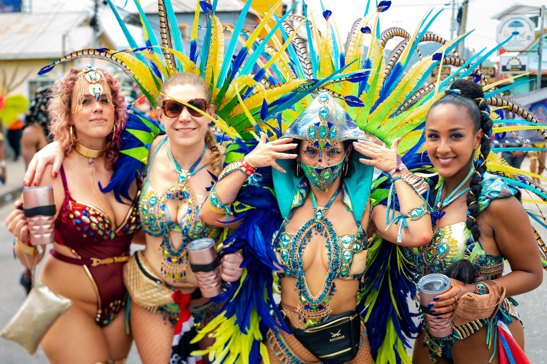 Women in feathered costumes at carnival