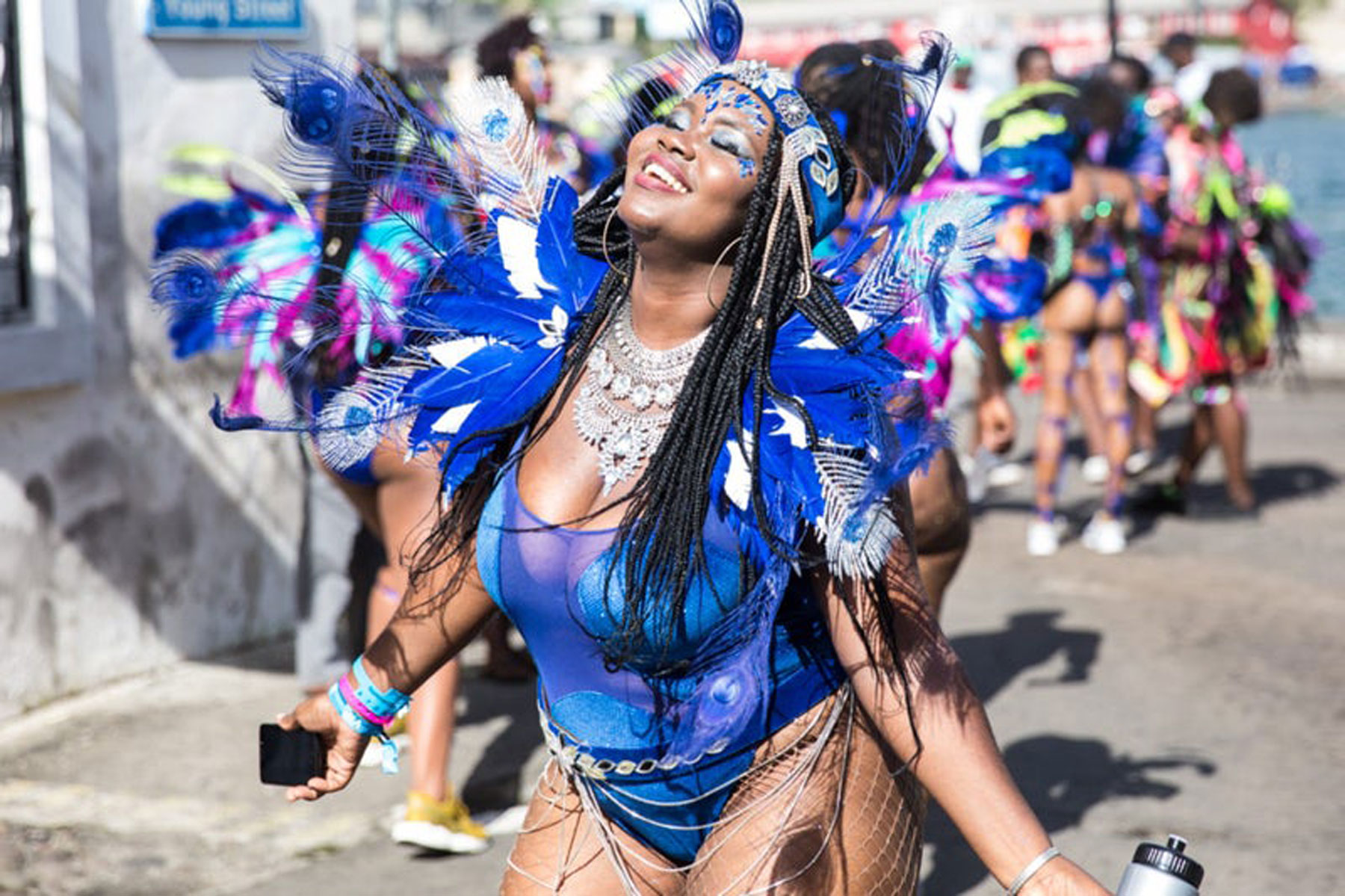 Woman in blue carnival outfit dancing