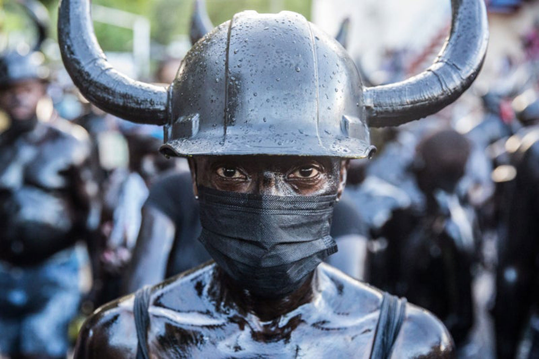 man looking straight at camera in black helmet with horns