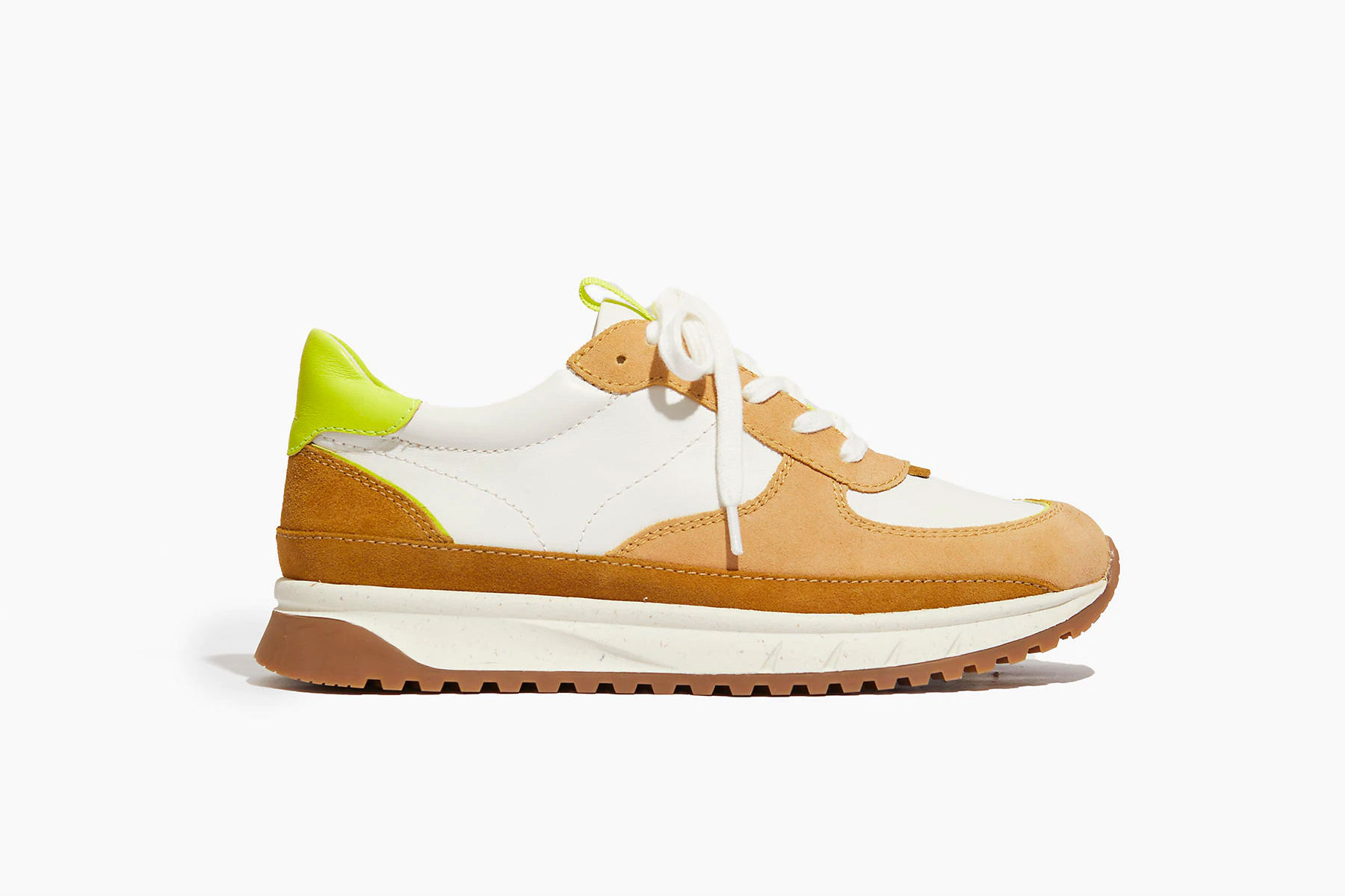White, tan, and neon green sneakers