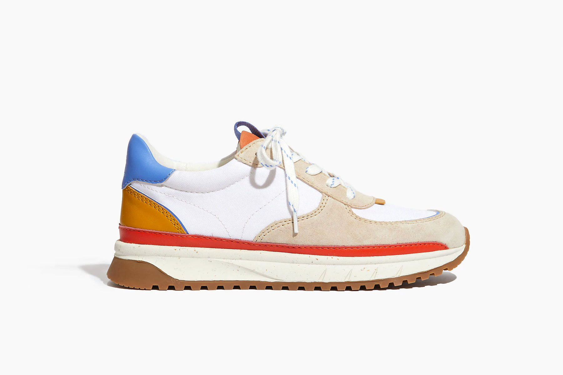 White, tan, blue, and red sneakers