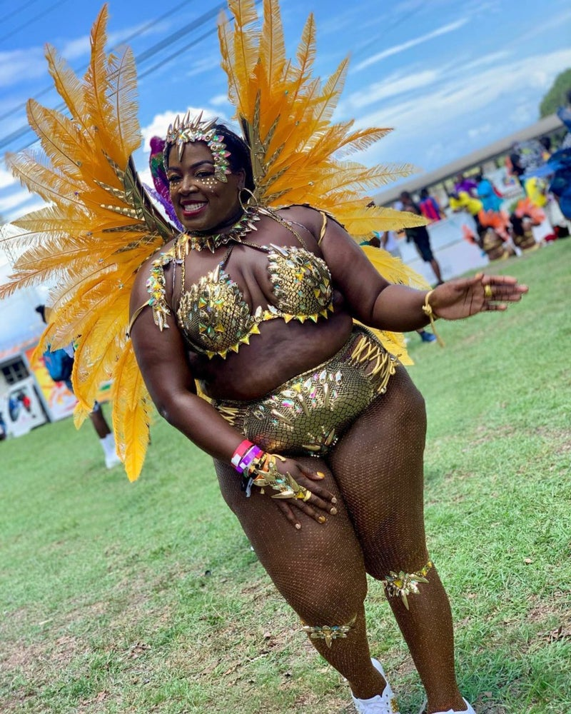 Woman in stunning gold carnival outfit