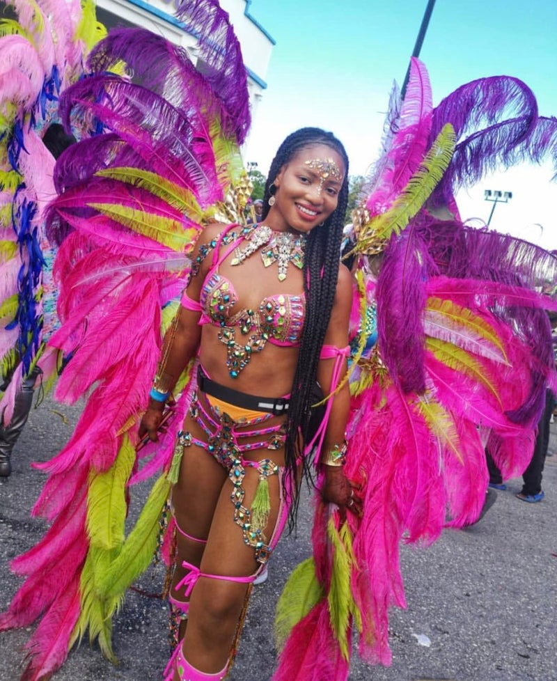 Woman in pink carnival outfit