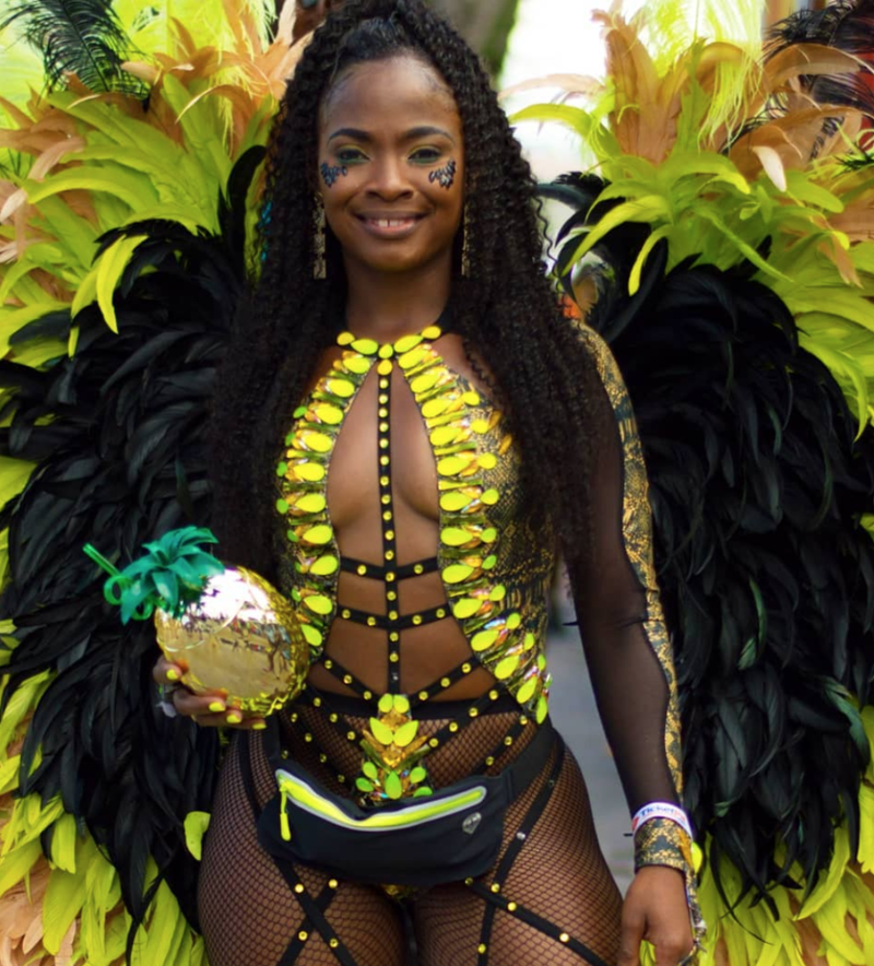 Woman in yellow carnival outfit