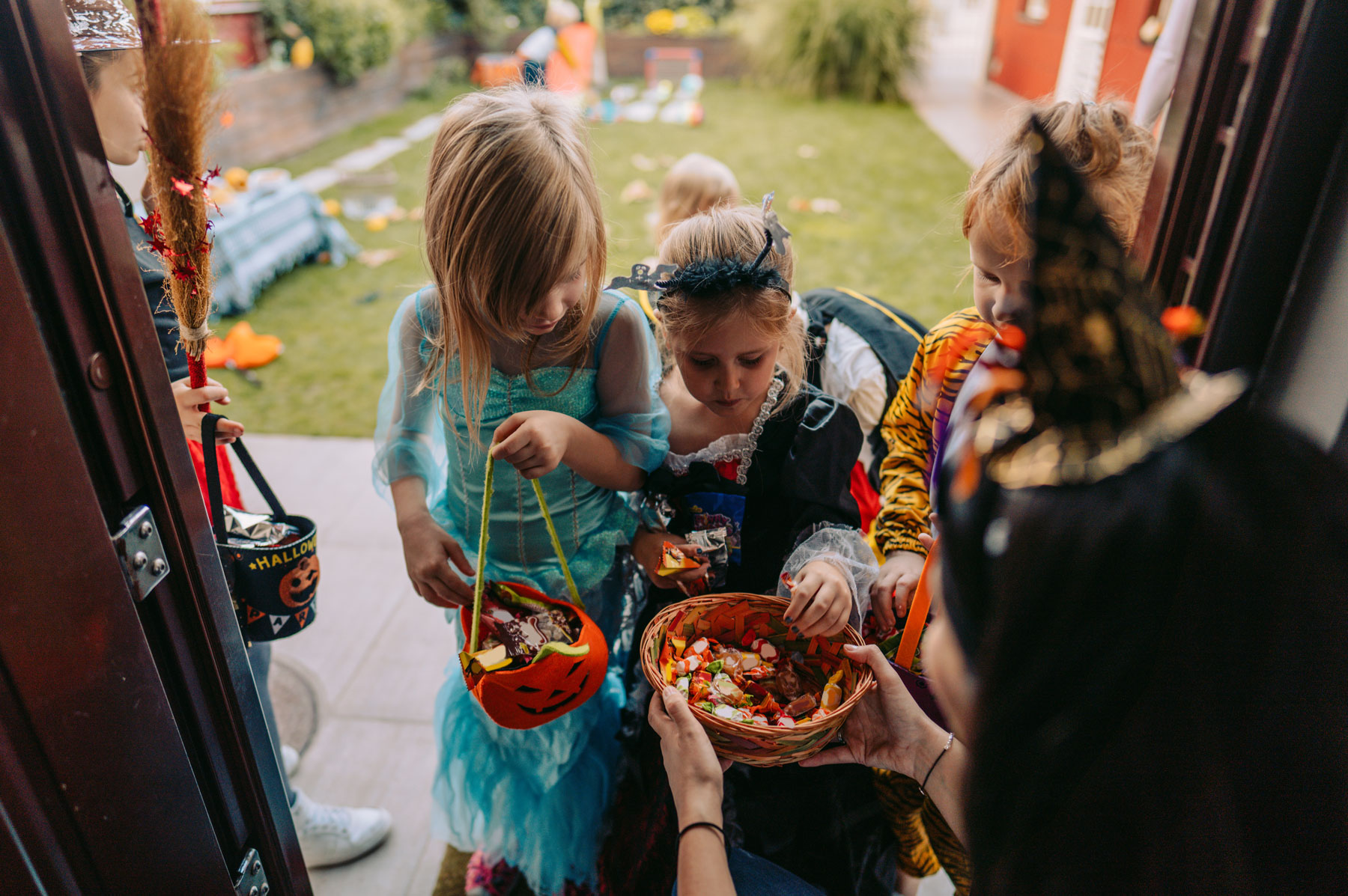 children in costumes trick-or-treating