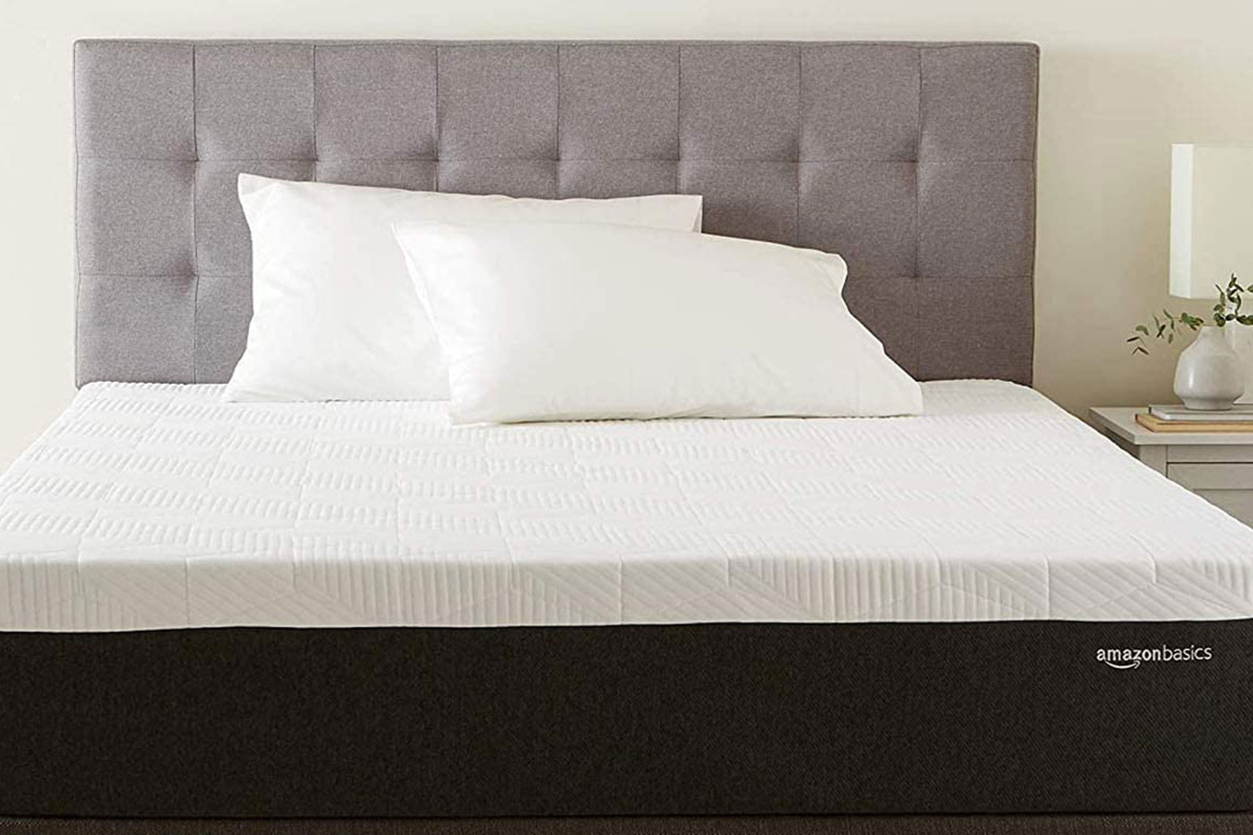 Mattress on bed with headboard
