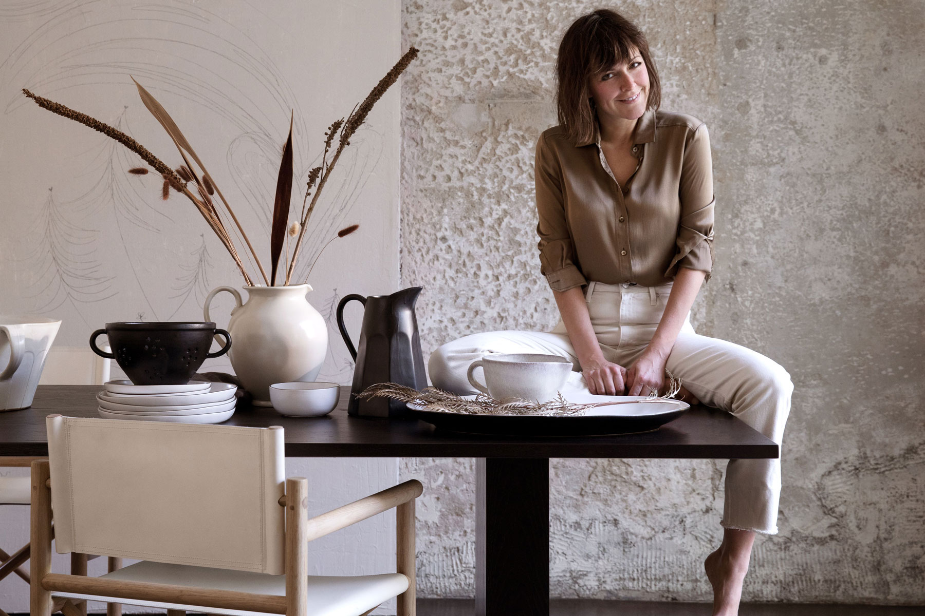 Leanne Ford sitting on table