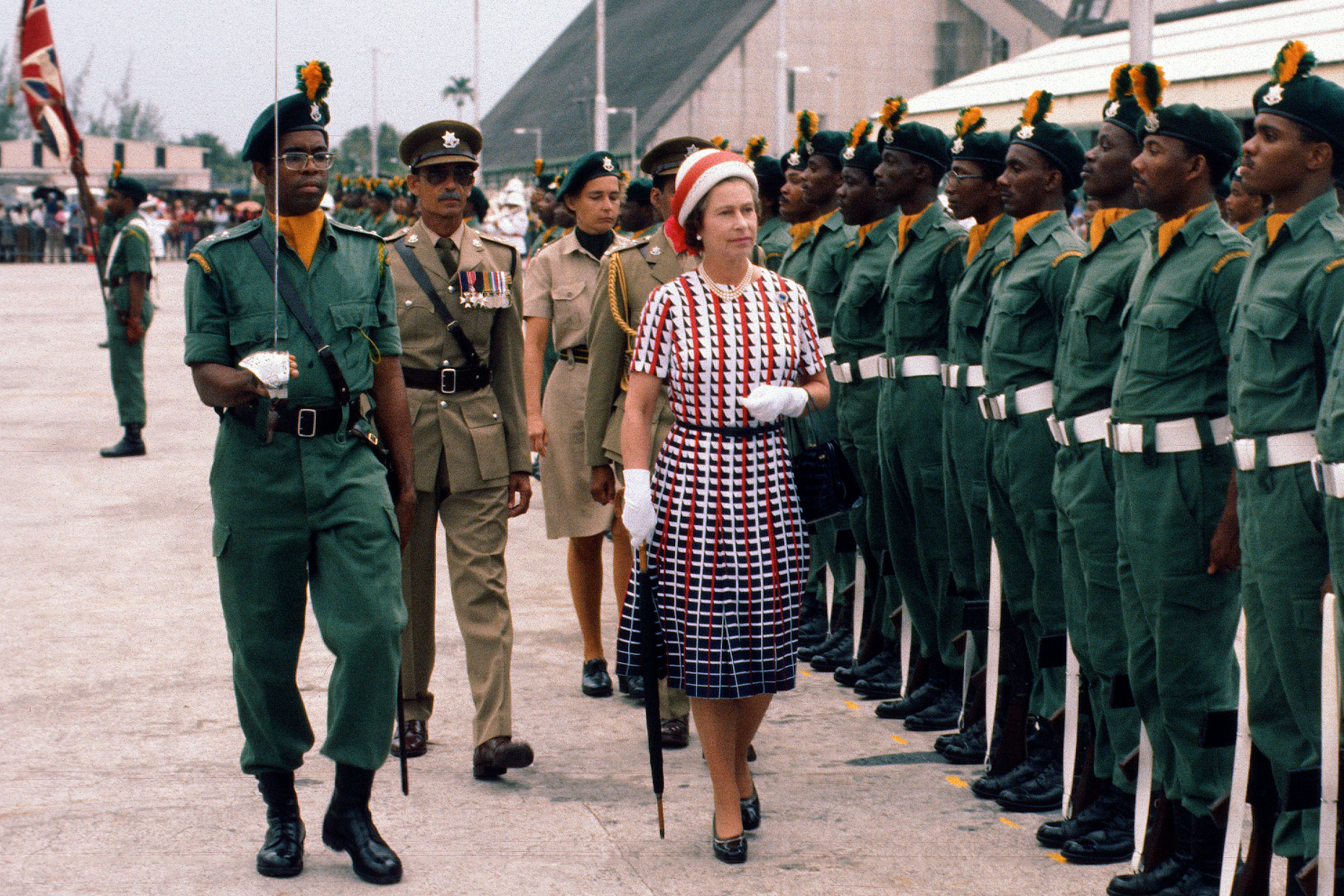 Queen Elizabeth II inspects a guard of honour as she arrives in Barbados