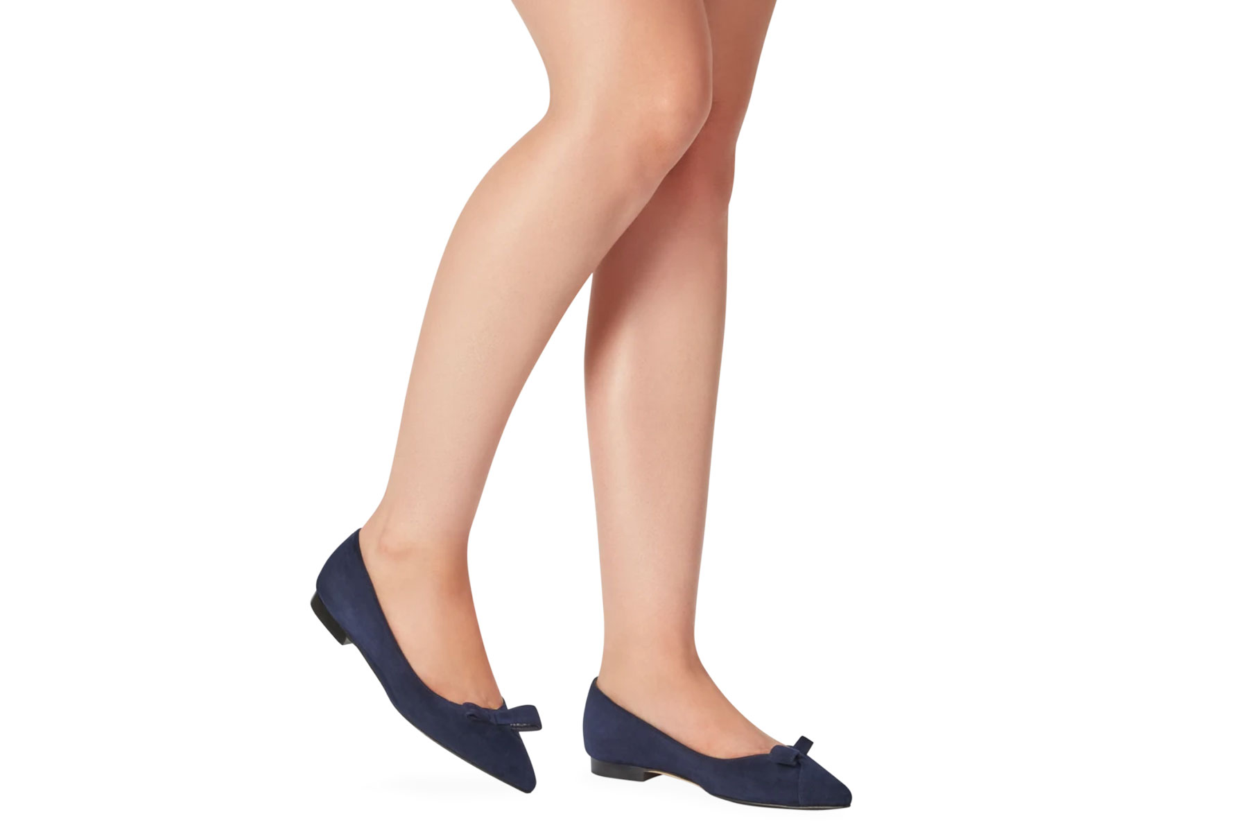 Woman wearing navy pointed toe flats