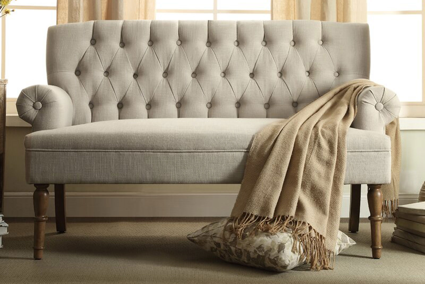 Tan sofa with blanket