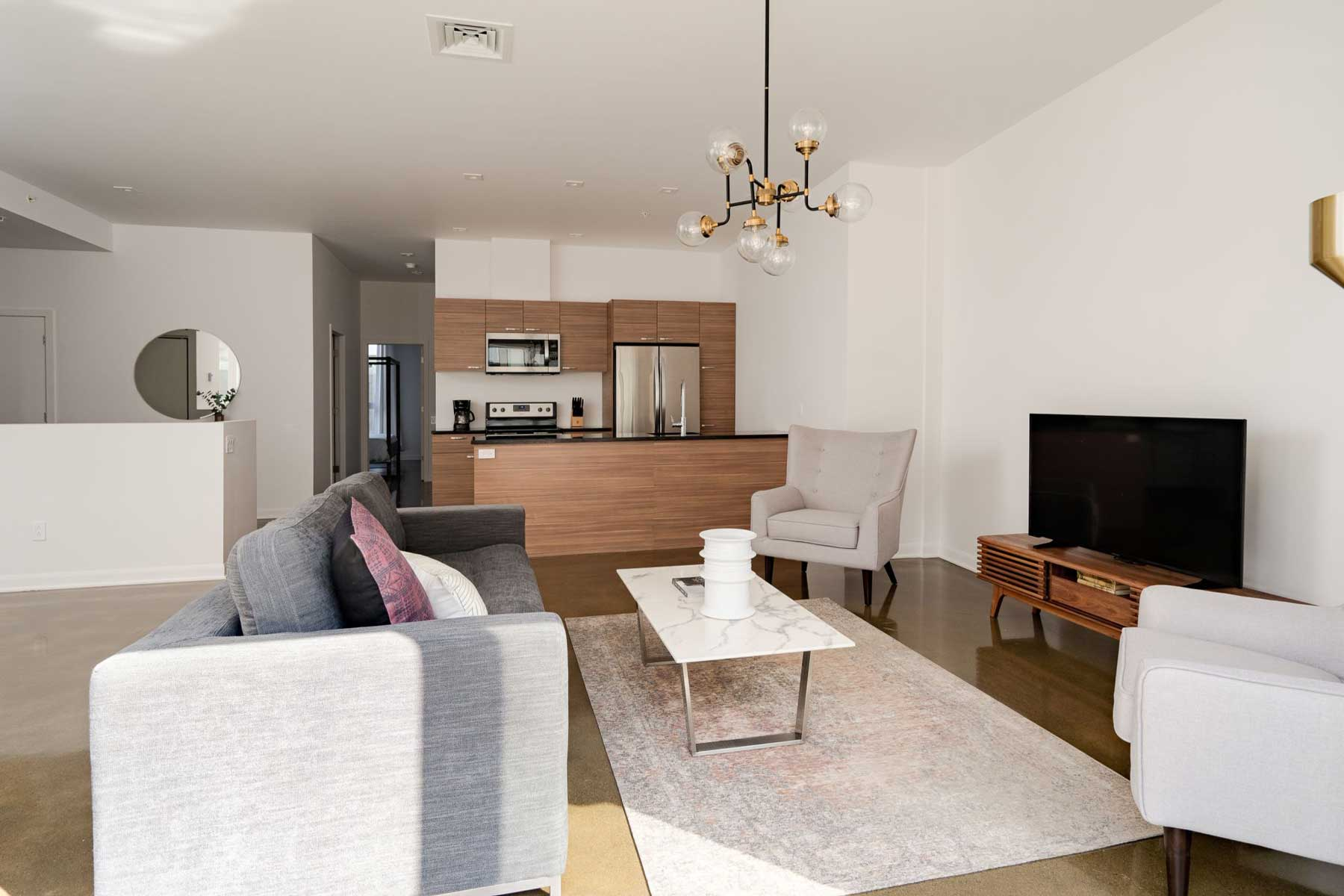 Living room and kitchen Sonder rental in Montreal