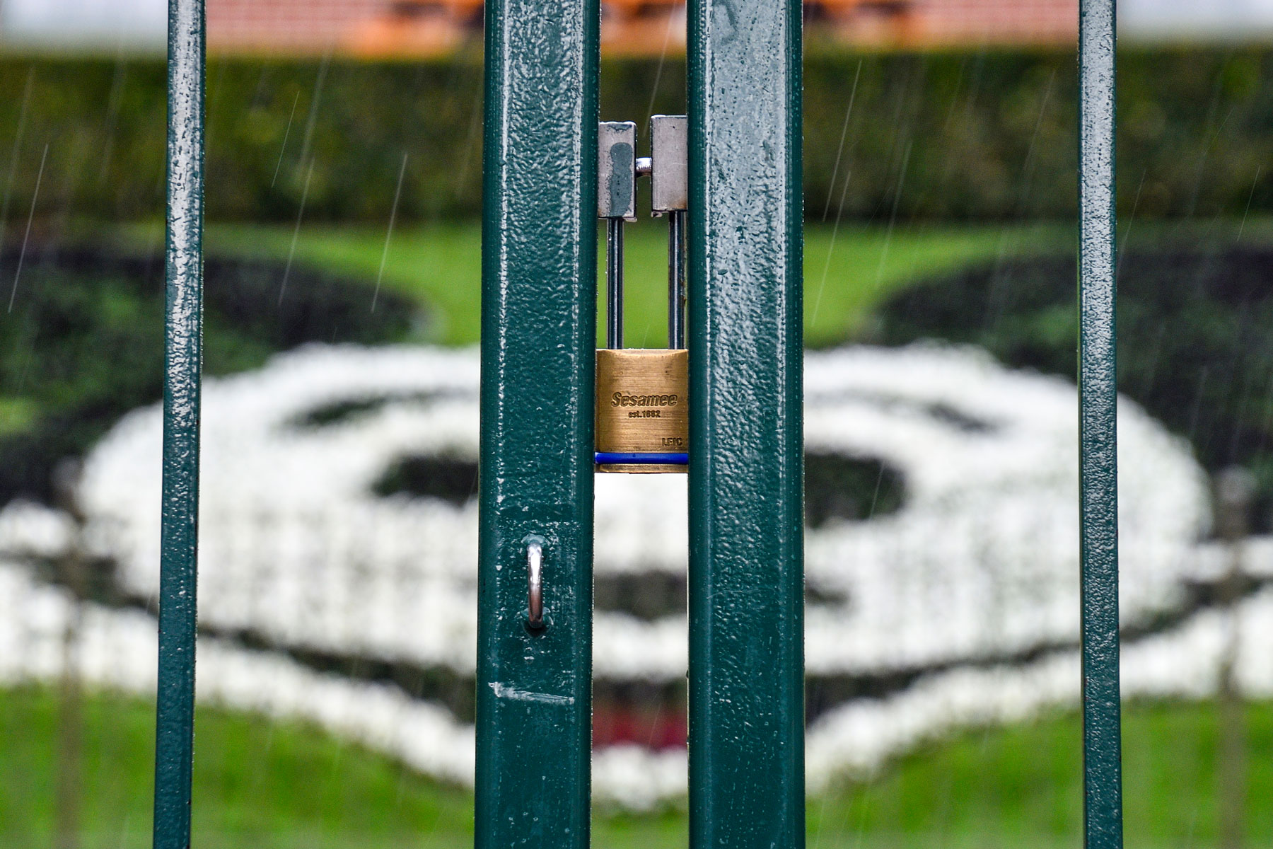 A lock hangs on the center gate between the turnstiles at the entrance to Disneyland