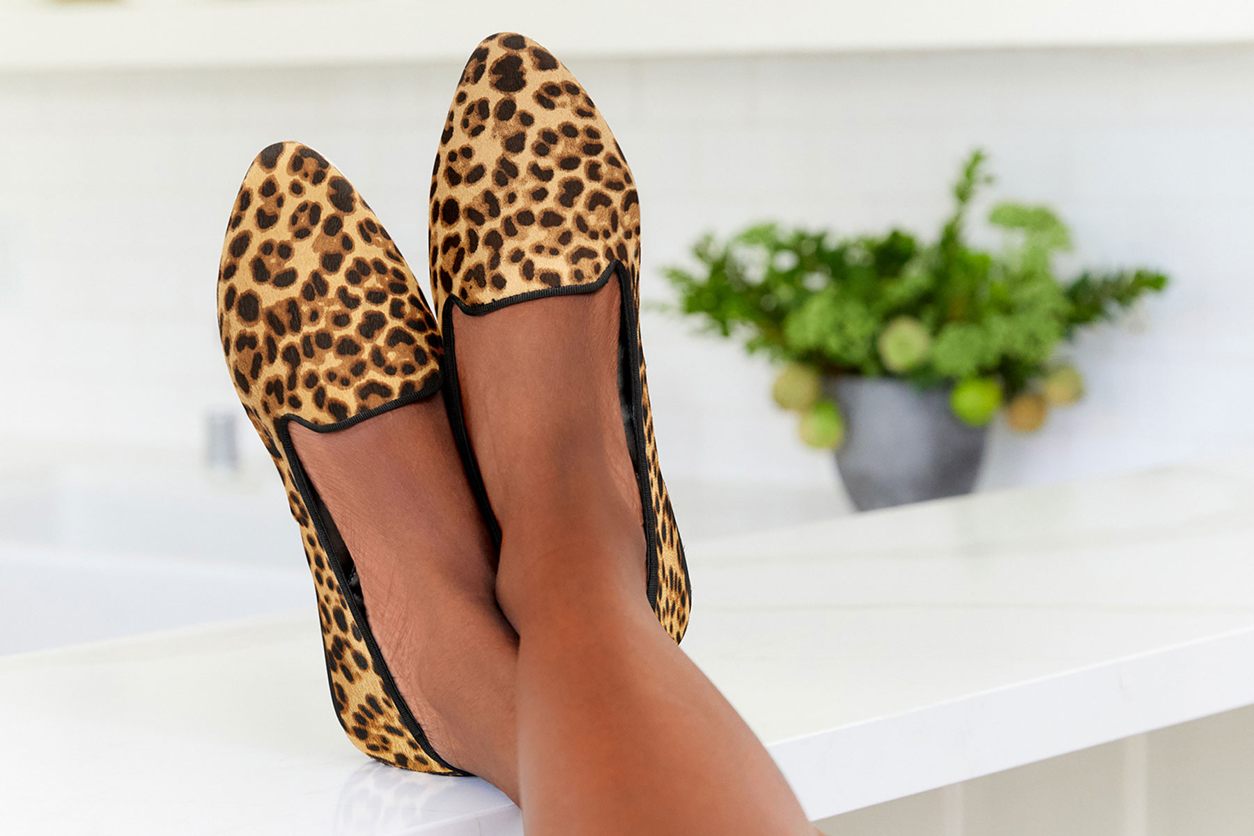 Woman wearing cheetah print pointed toe flats