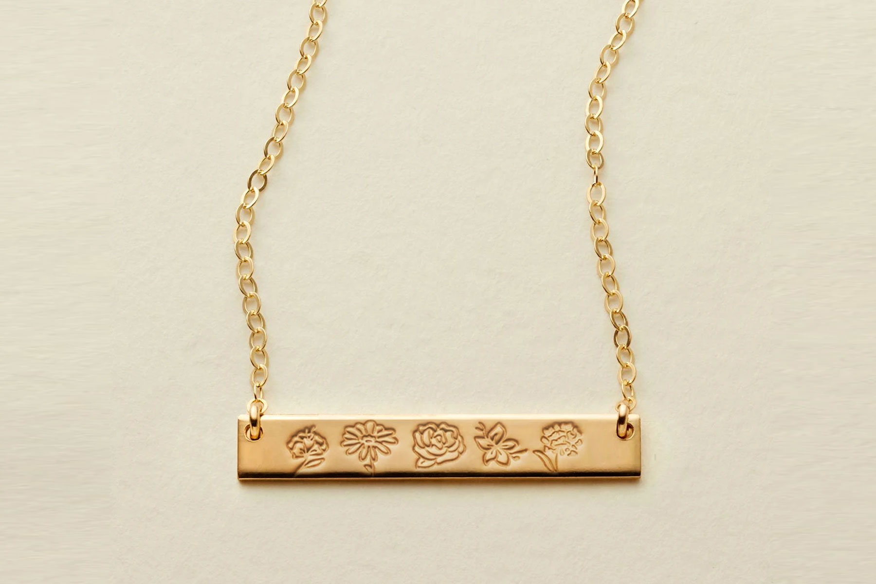Gold bar necklace with flowers