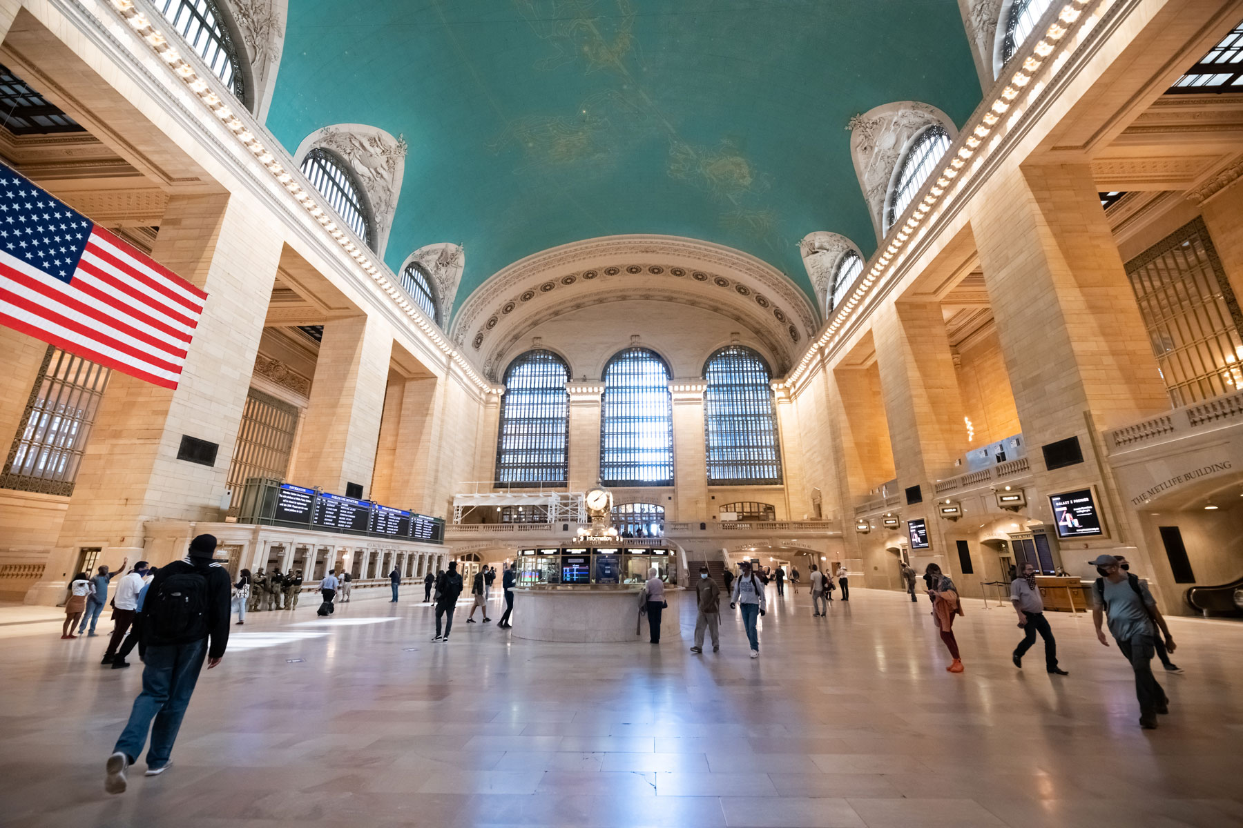 people walk inside of Grand Central Terminal