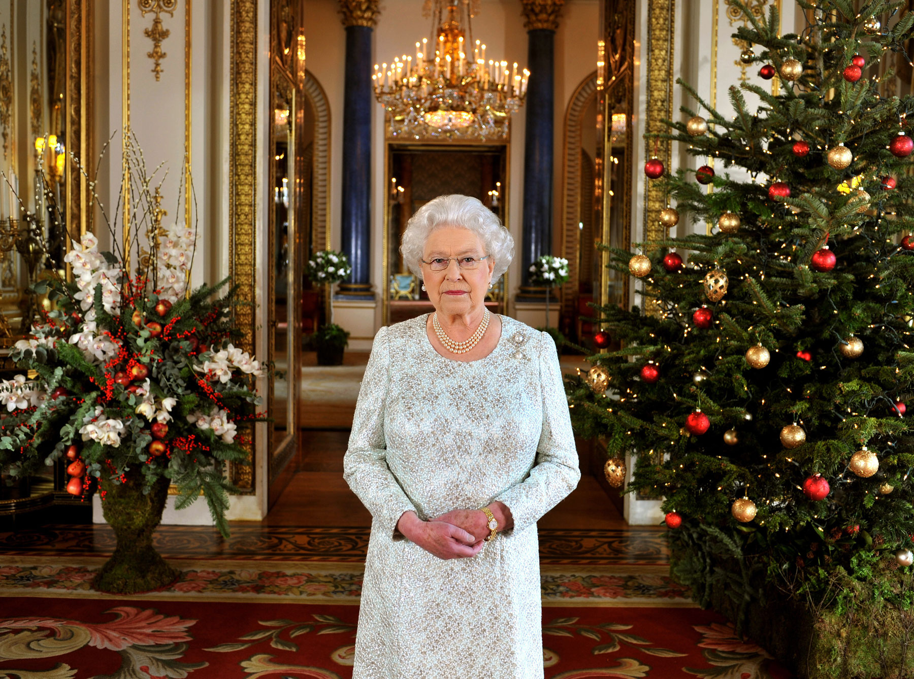 Queen Elizabeth II surrounded by Christmas decor