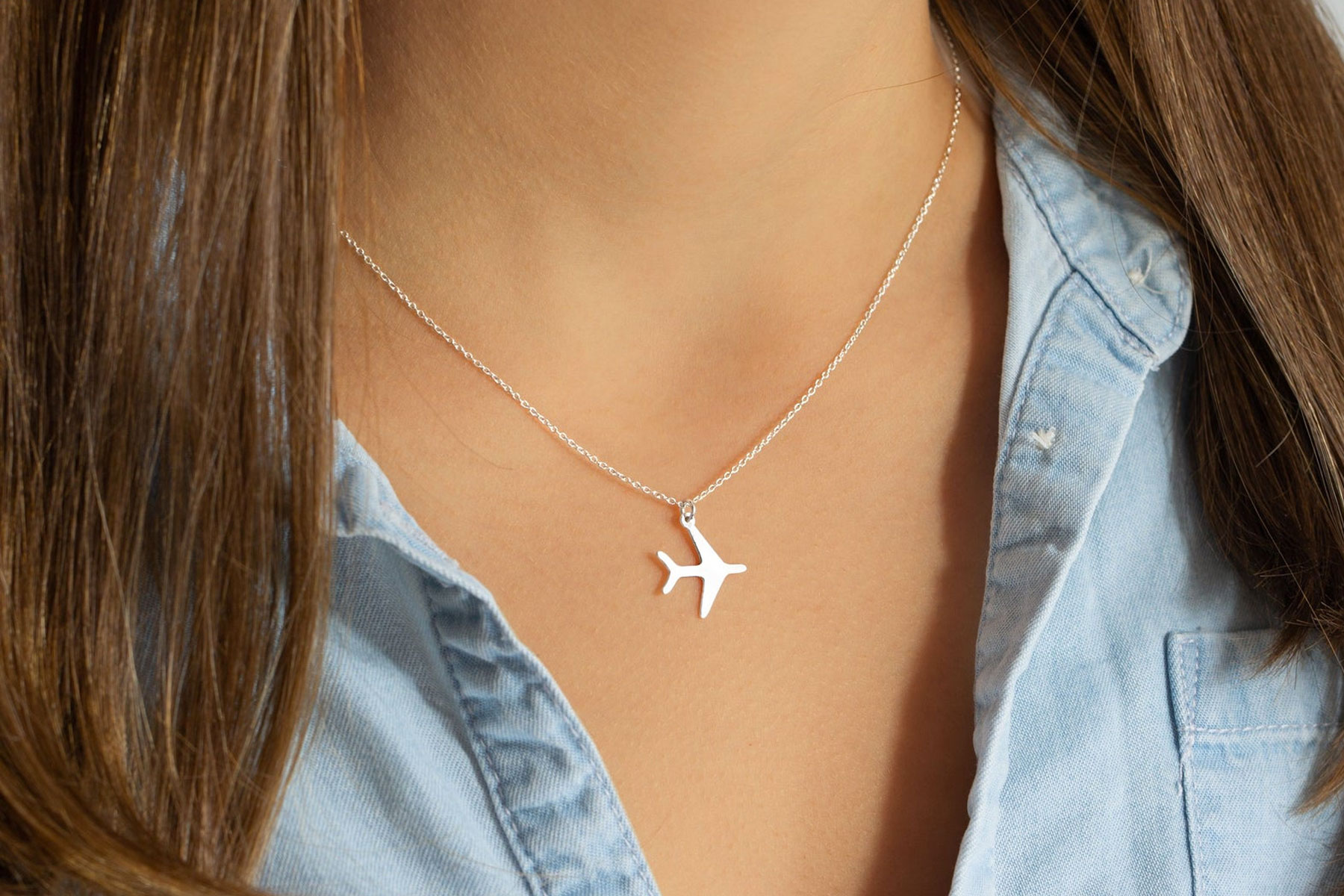 silver airplane necklace