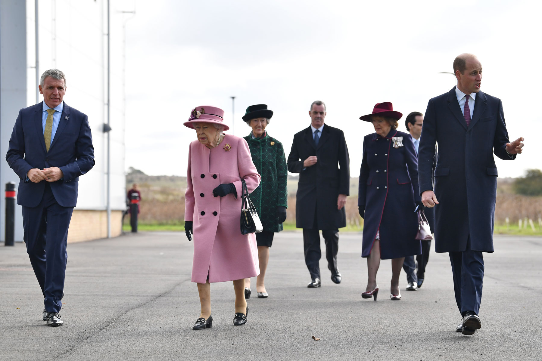 Queen Elizabeth and Prince William arrive with Dstl Chief Executive Gary Aitkenhead at the Energetics Analysis Centre