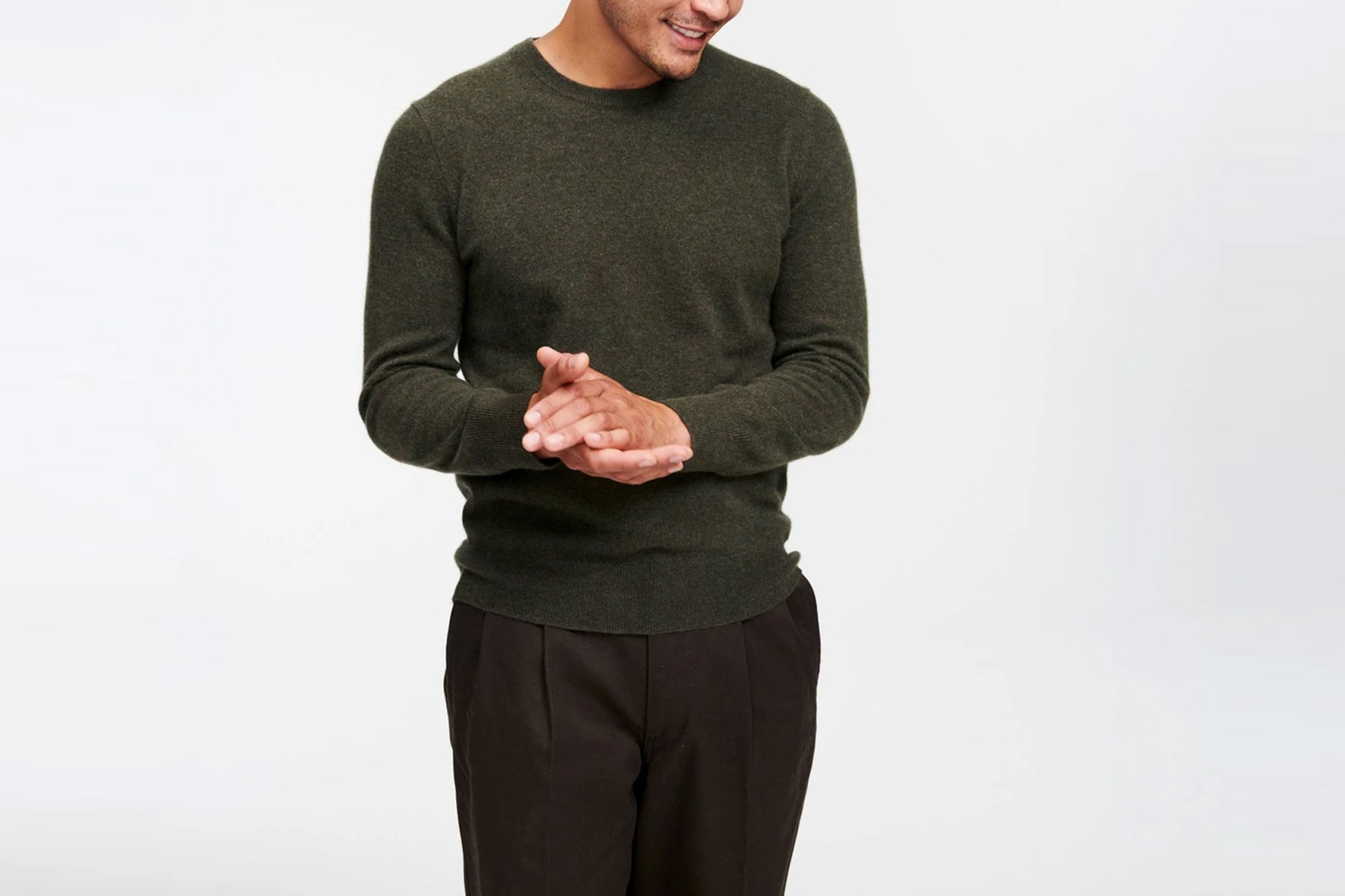 Man wearing olive green sweater