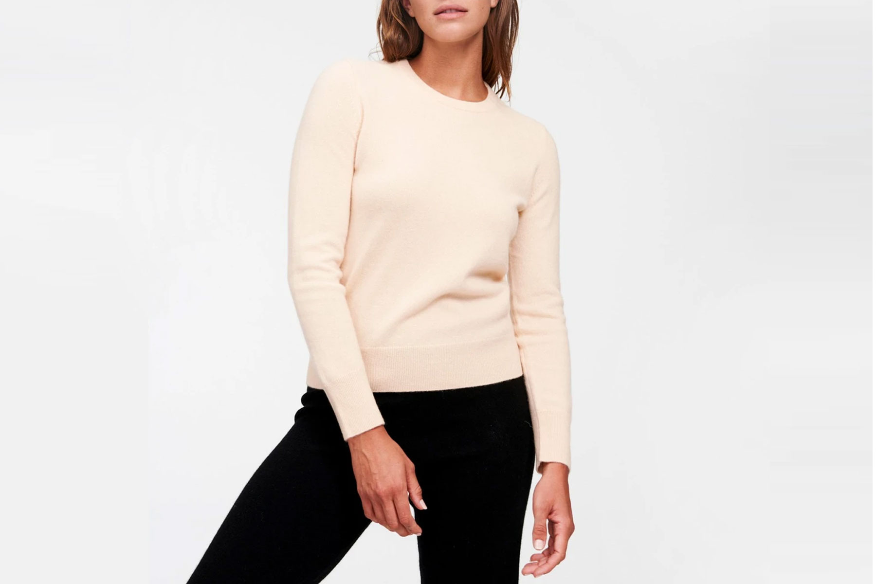 Woman wearing cream colored sweater