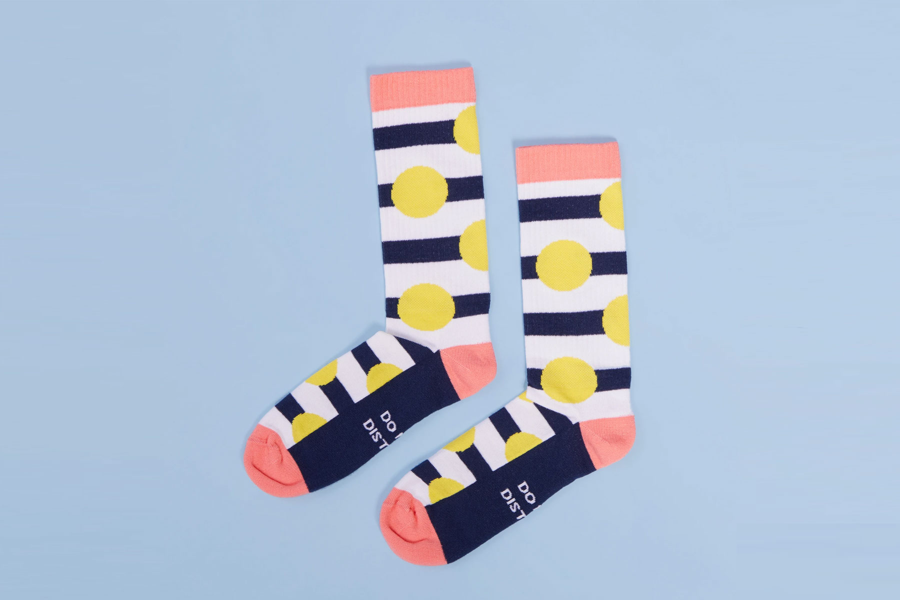 Pink, yellow, and navy patterned socks