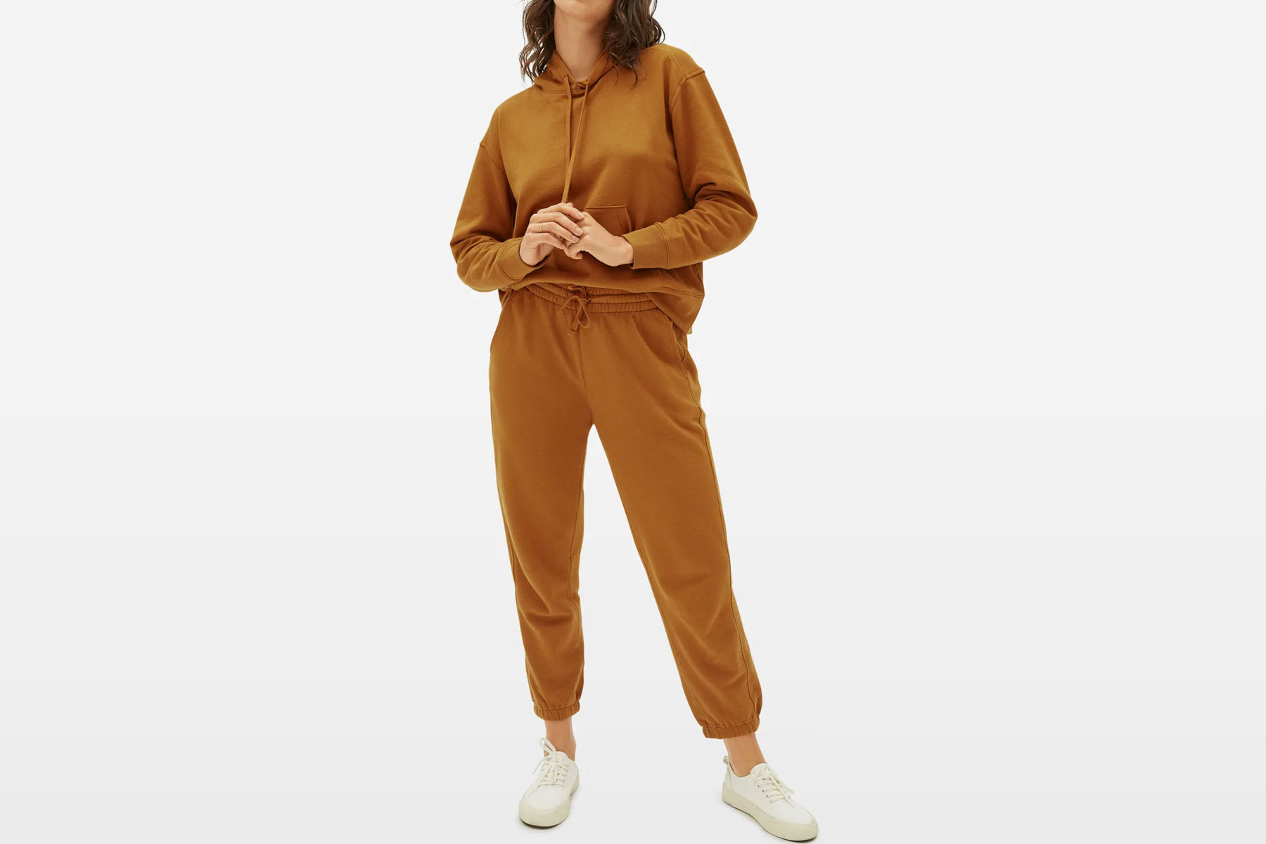 Woman wearing camel/tan sweatsuit