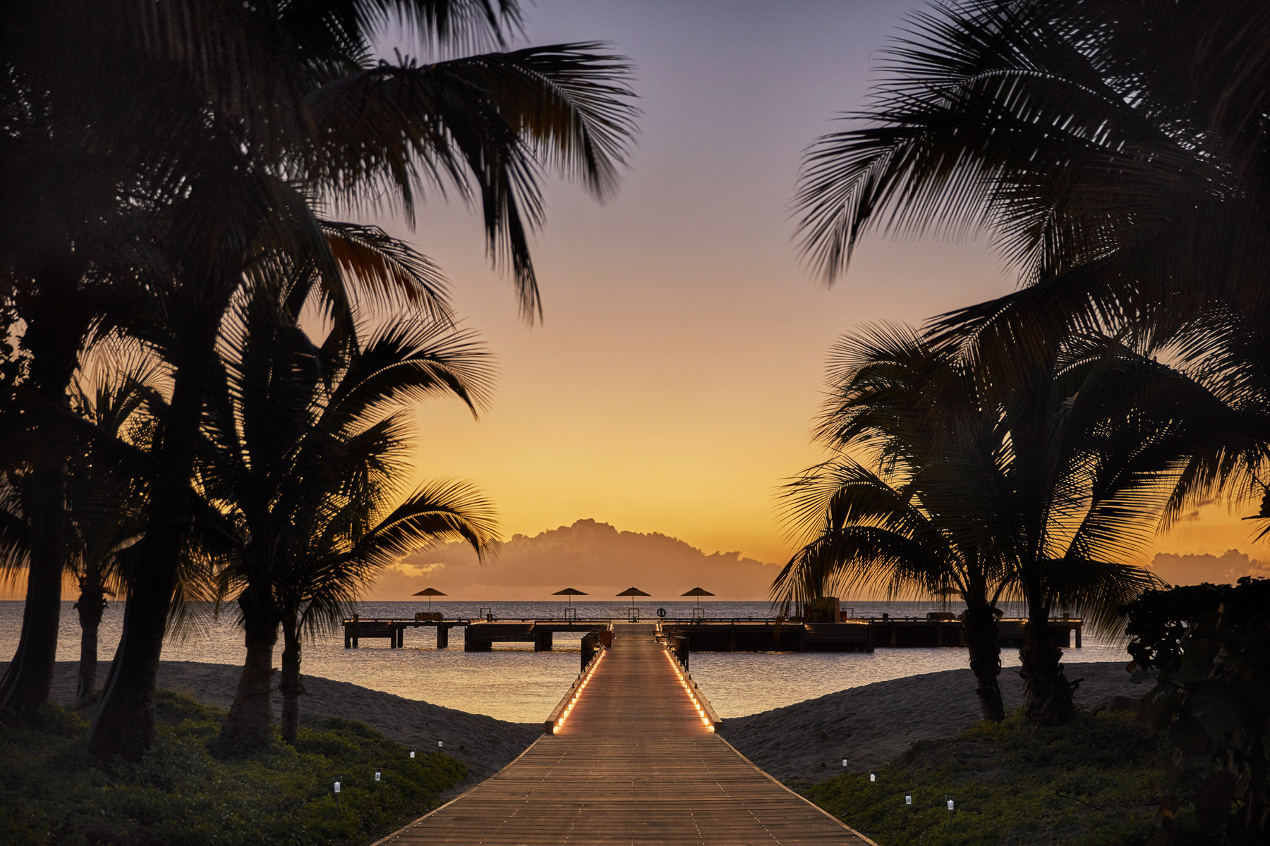 Walkway to overwater dock at sunset