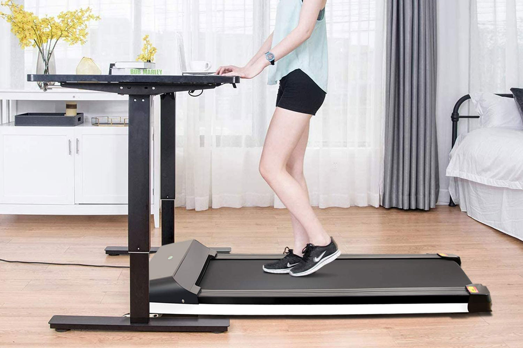 Woman on treadmill at standing desk