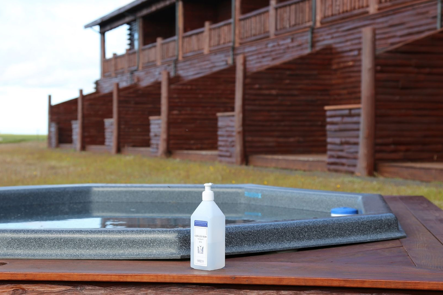 A hot tub with hand sanitizer