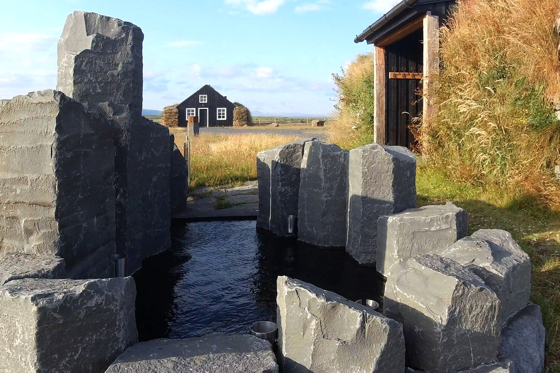 Landscape of water feature and cottage in Iceland