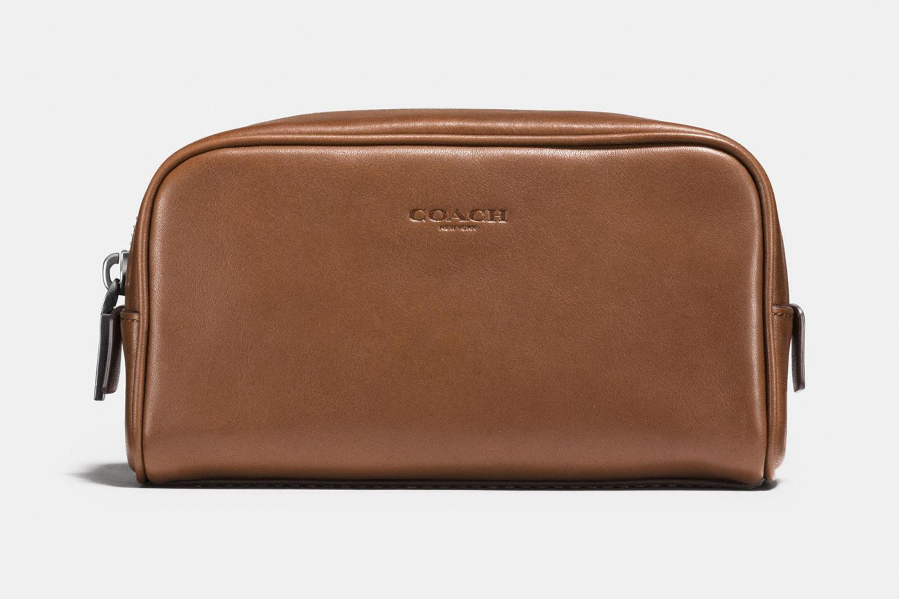 Coach's brown leather Dopp kit