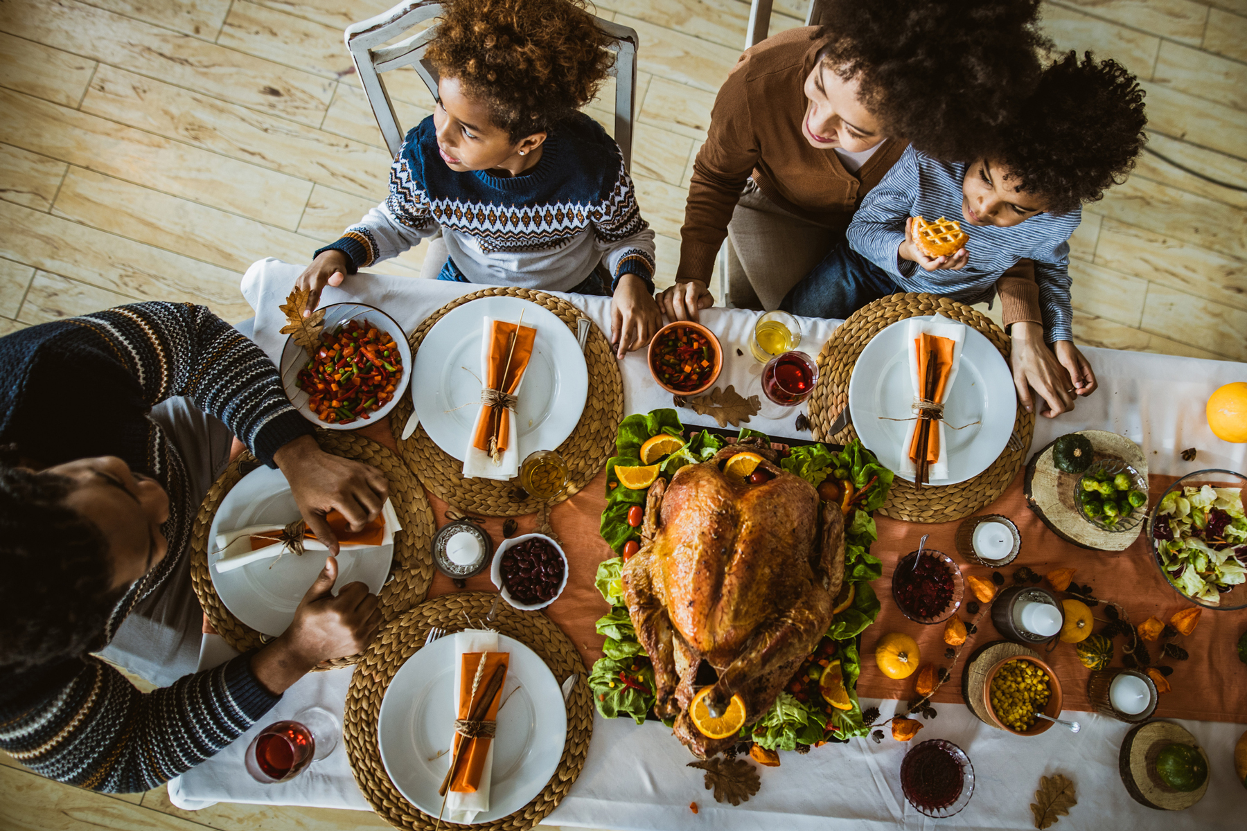 Above view of a family during Thanksgiving meal at dining table.