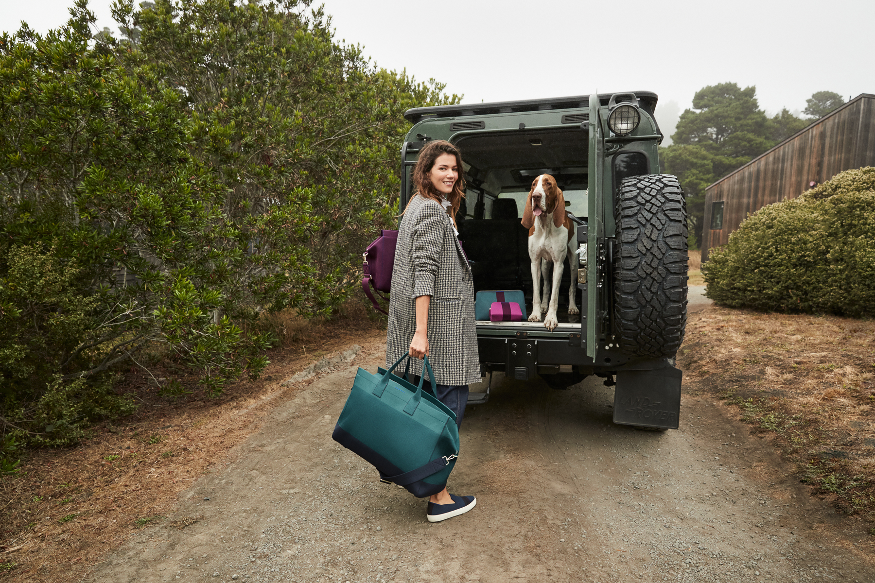 Rothy's lifestyle model with weekender tote in Deep Spruce, going on a road trip