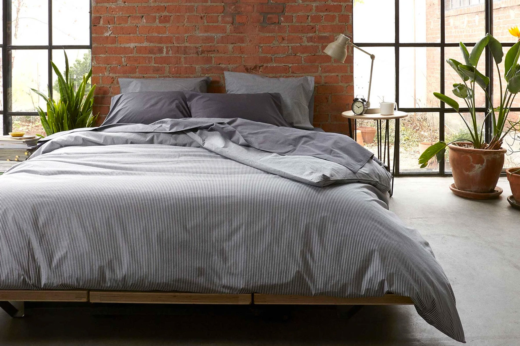 Grey bedding and comforter on bed