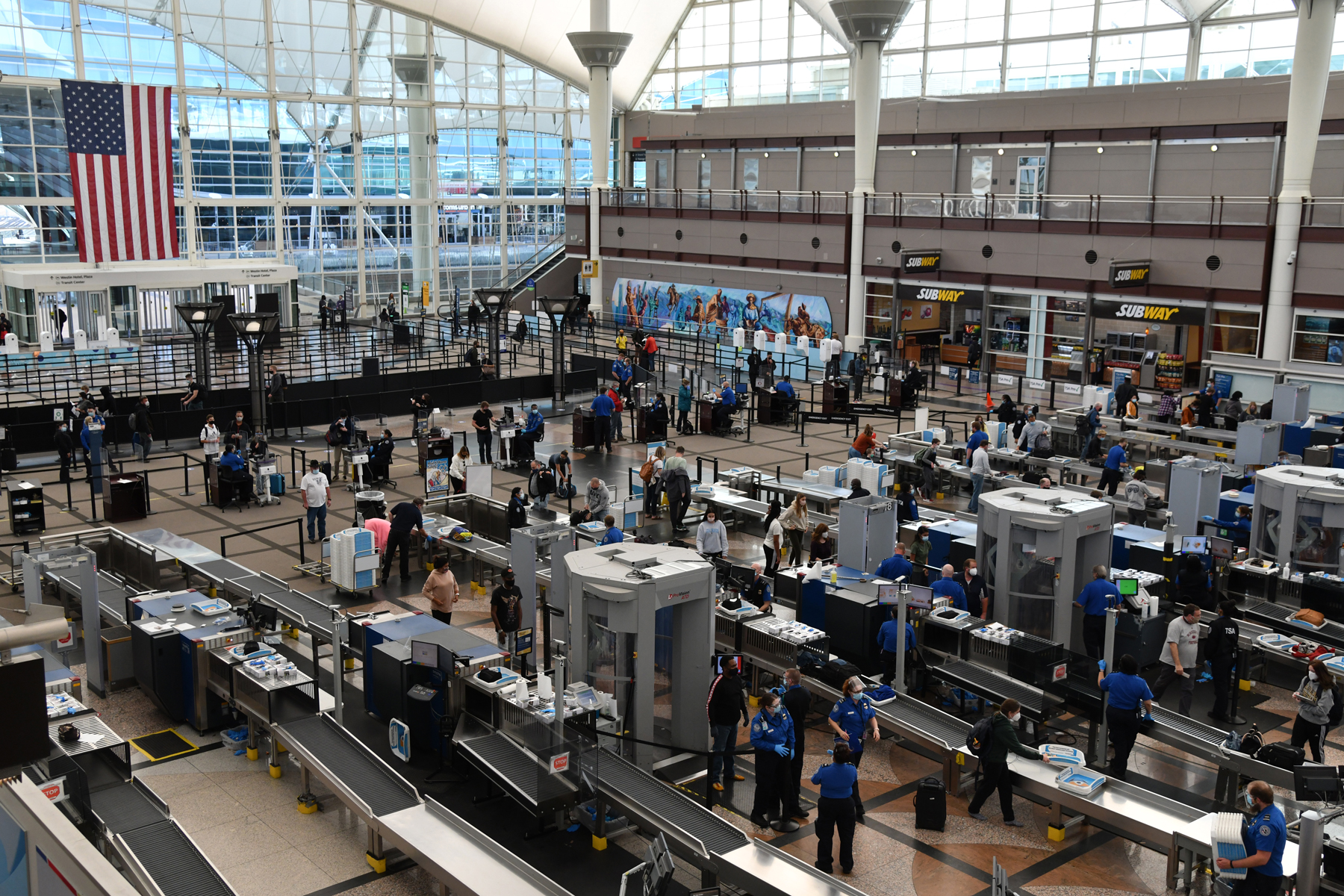 TSA crews are checking baggages of travelers at a security check point