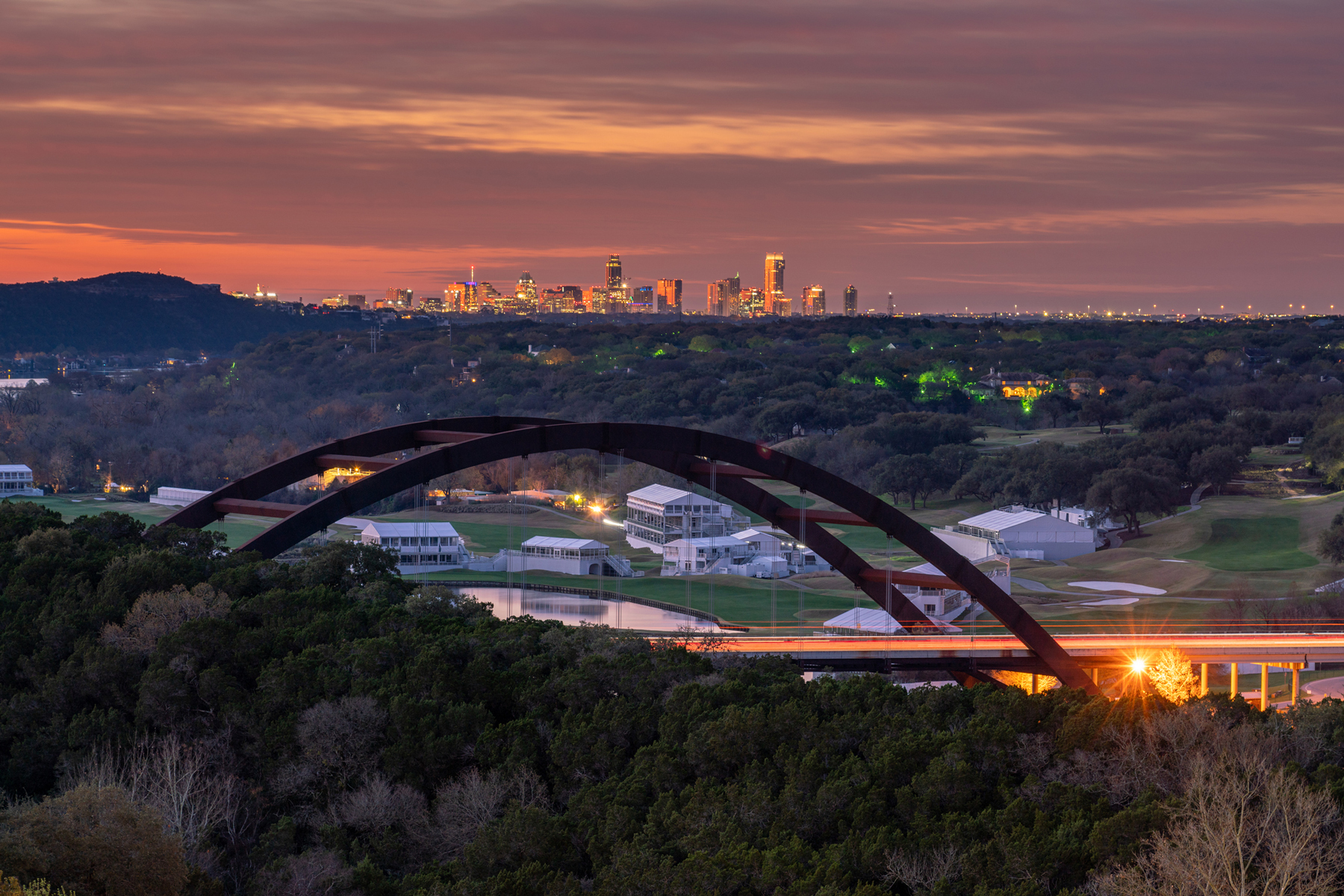Early Sunrise View of the Light up Austin Skyline With the 360 Bridge in the Foreground