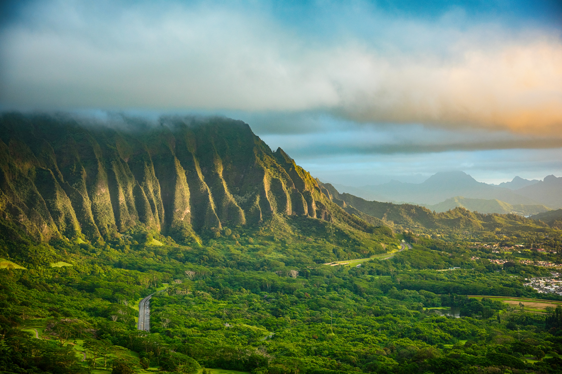 The beautiful landscape of interior Oahu at sunrise just after a storm had cleared.