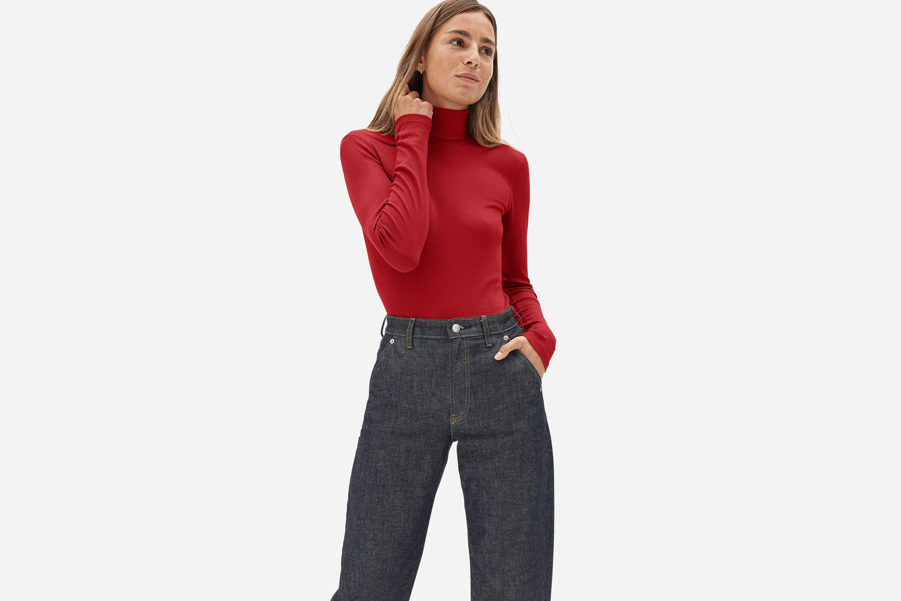 Woman wearing red cotton turtleneck