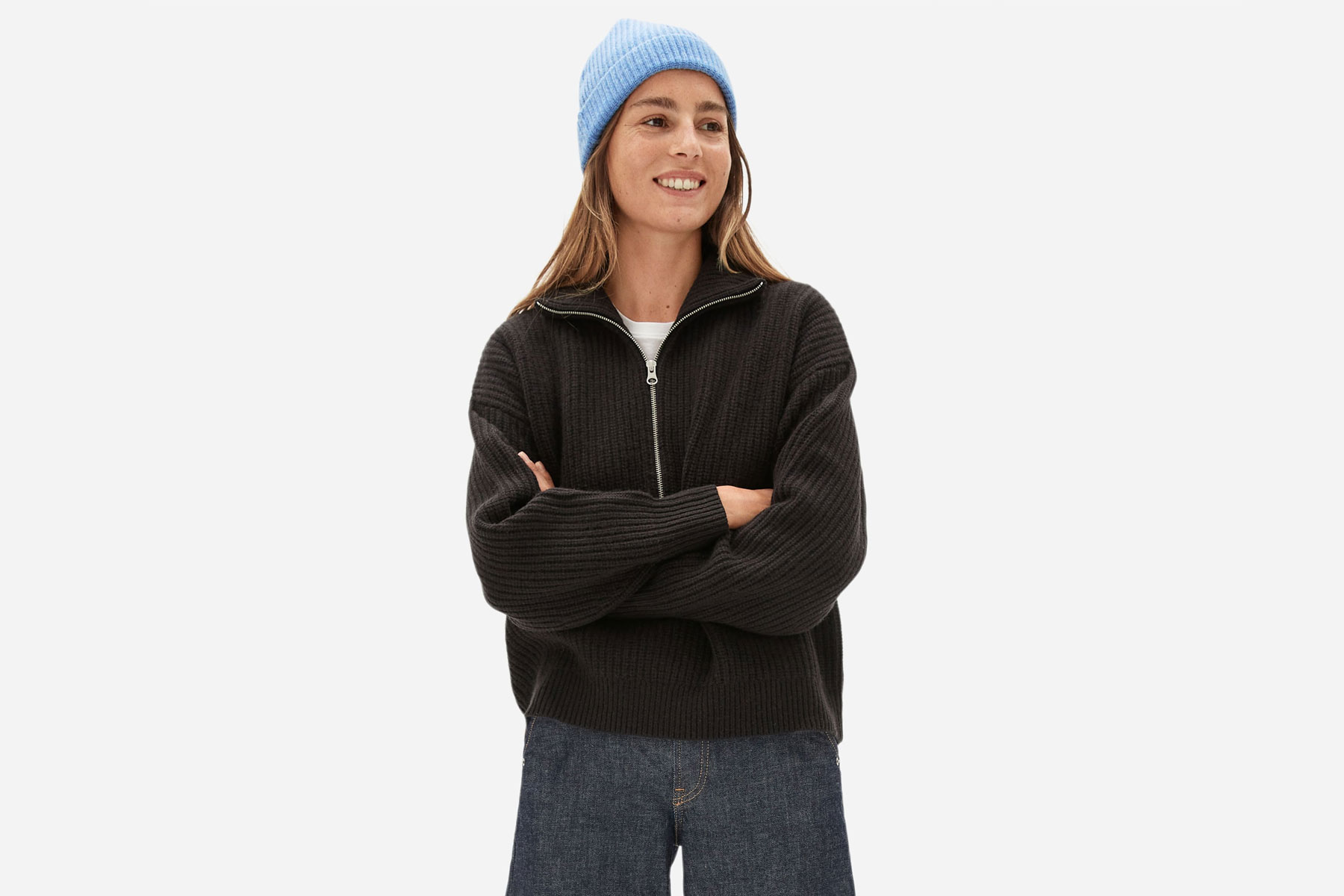 Woman wearing light blue knit beanie
