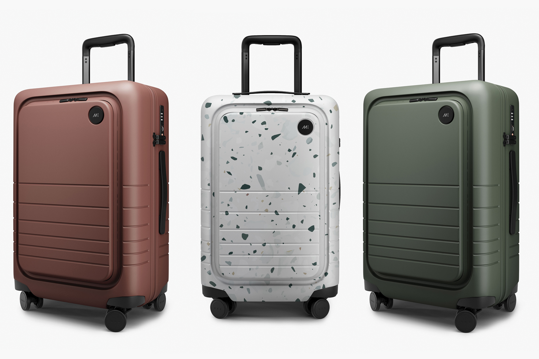 Monos Carry On Pro Hardside suitcases in terracotta, terrazzo and olive green